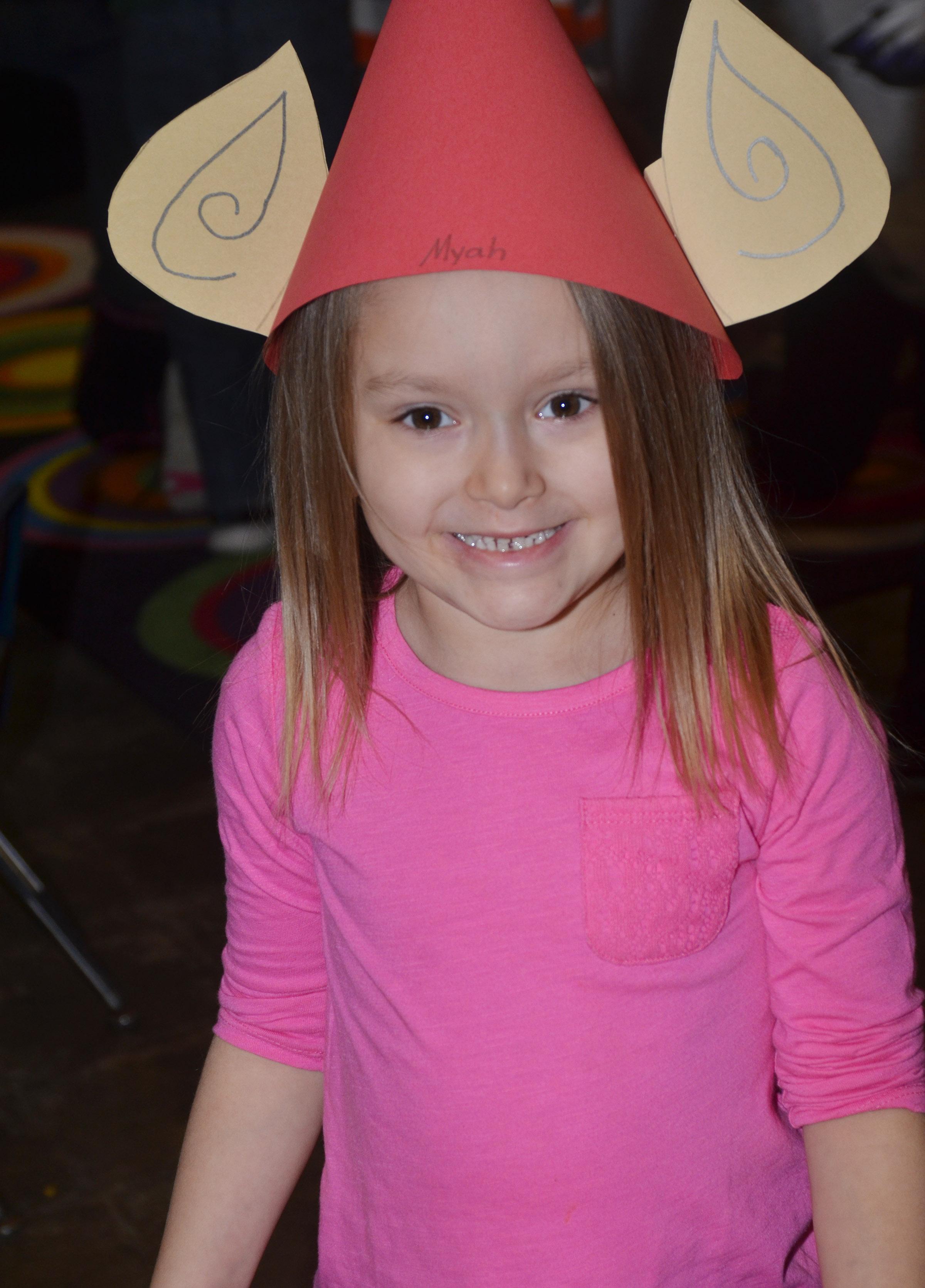 CES kindergartener Myah Learmond tries on her elf hat.