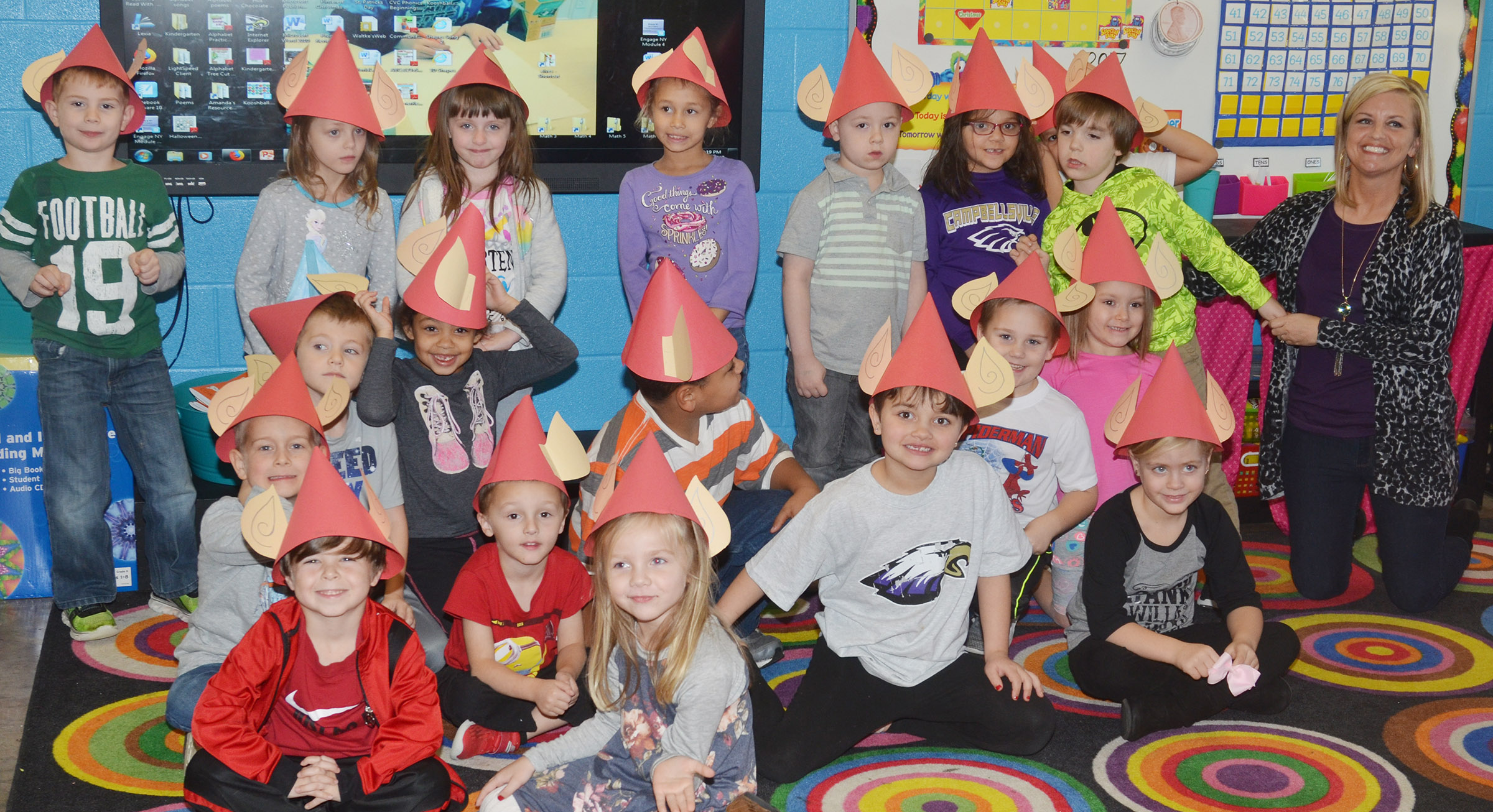 CES kindergarten students in Leanna Cundiff's class smile as they wear their elf hats.
