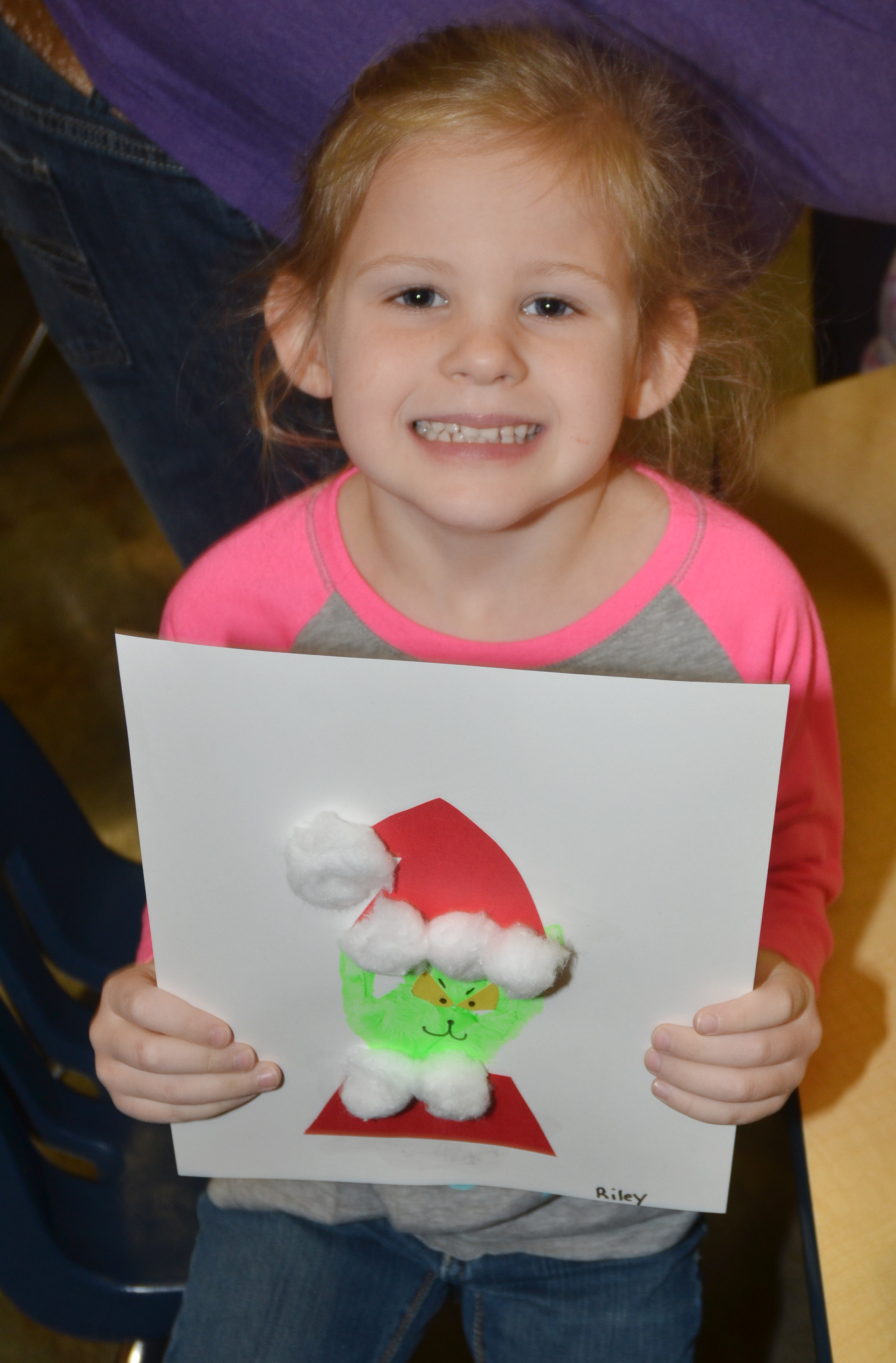 CES kindergartener Riley Bright holds her Grinch.