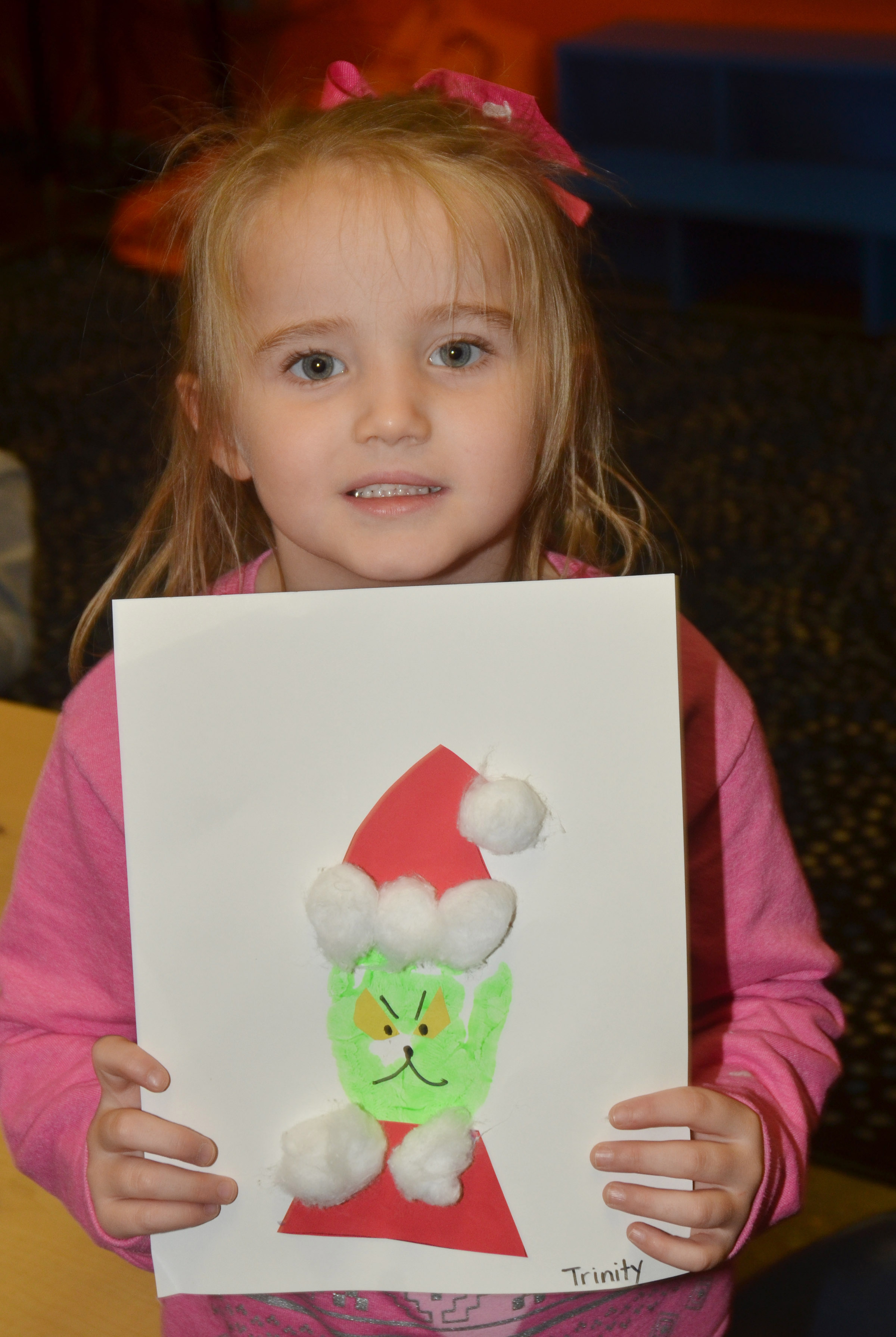 CES kindergartener Trinity Dye holds her Grinch.