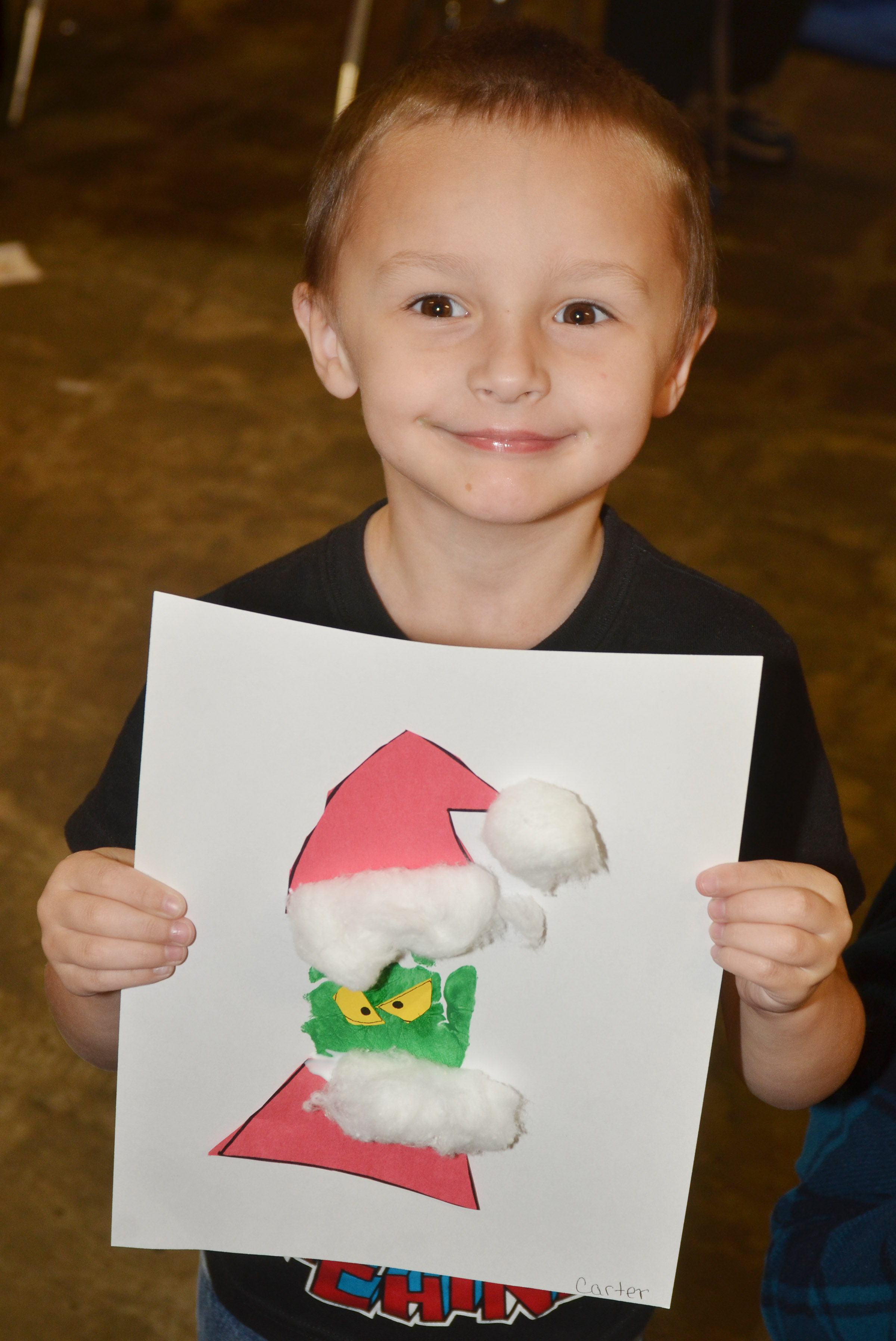 CES kindergartener Carter Ward holds his Grinch.