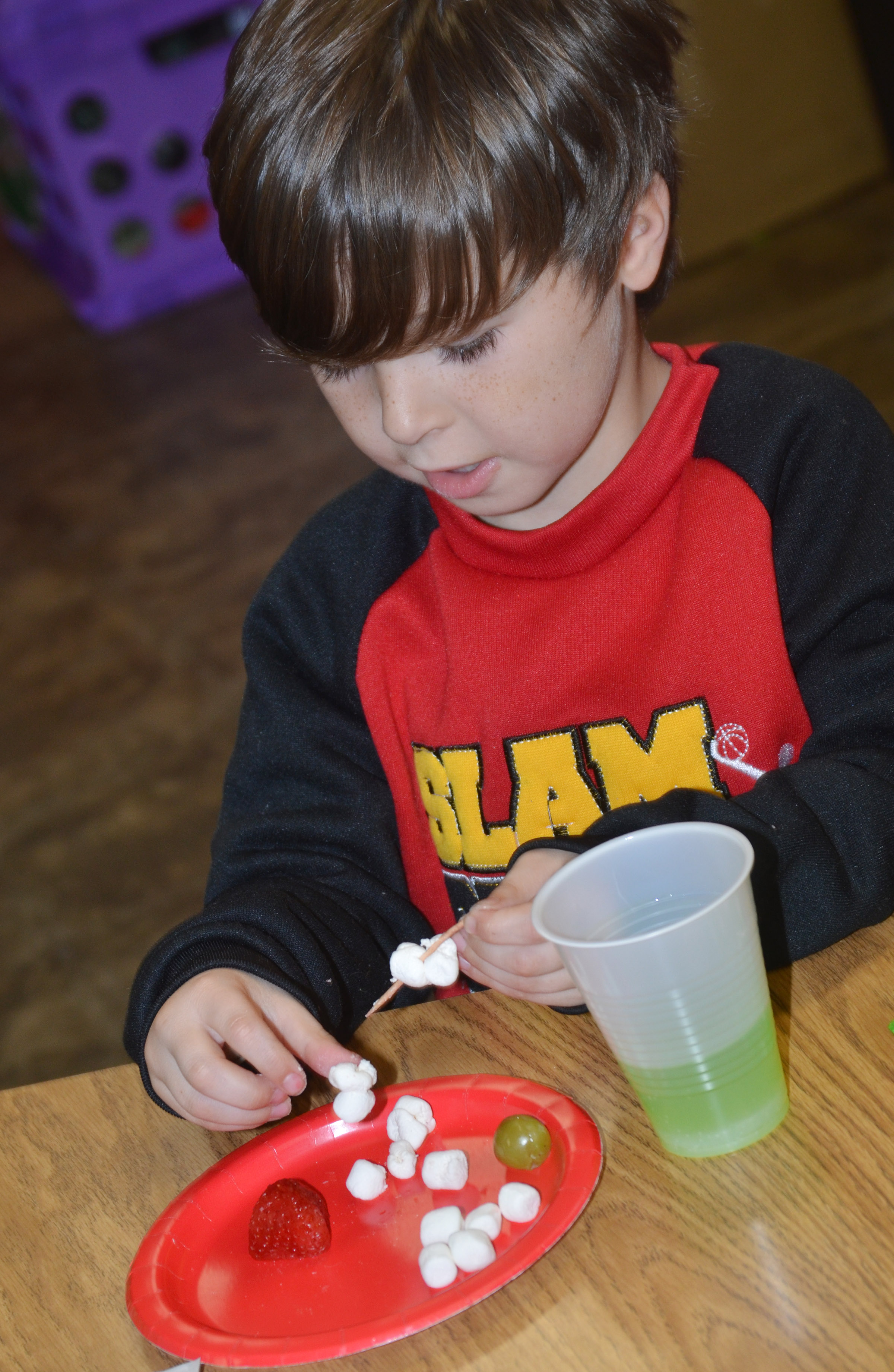 CES kindergartener Bentley Wilhoite makes his Grinch snack.