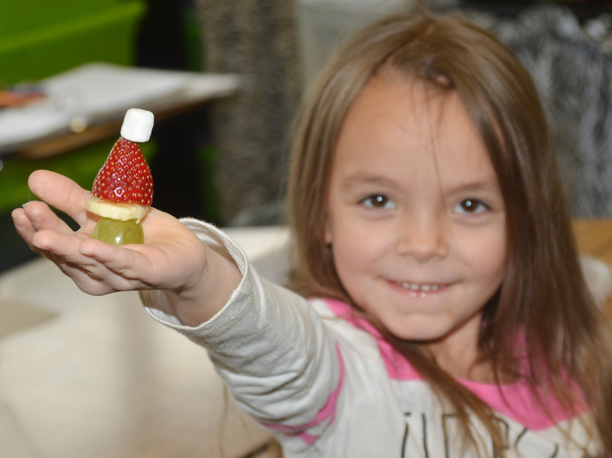CES kindergartener Kalie Pilkington holds her Grinch snack.