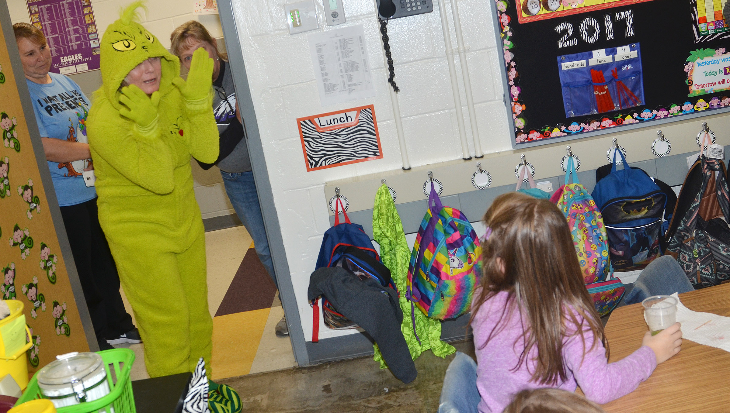 CES kindergarteners are surprised to see the Grinch stop by their classroom.