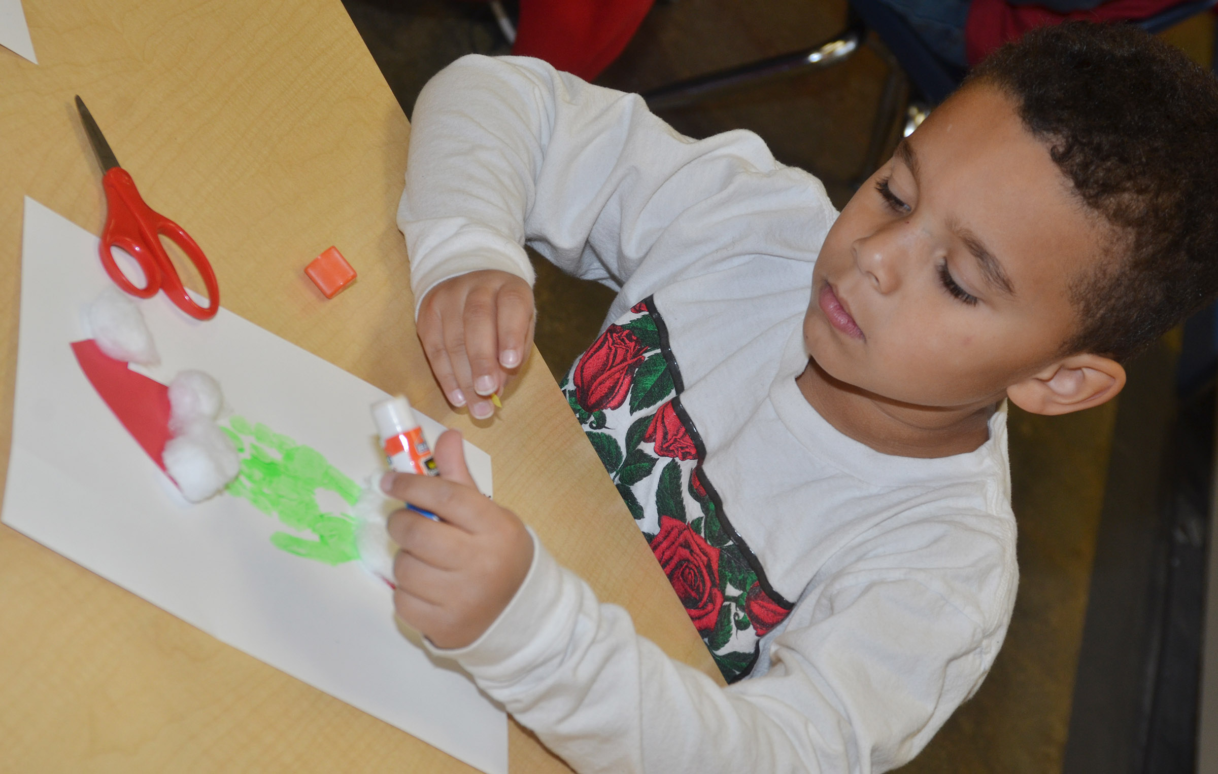CES kindergartener Tyrek Moore makes his Grinch.