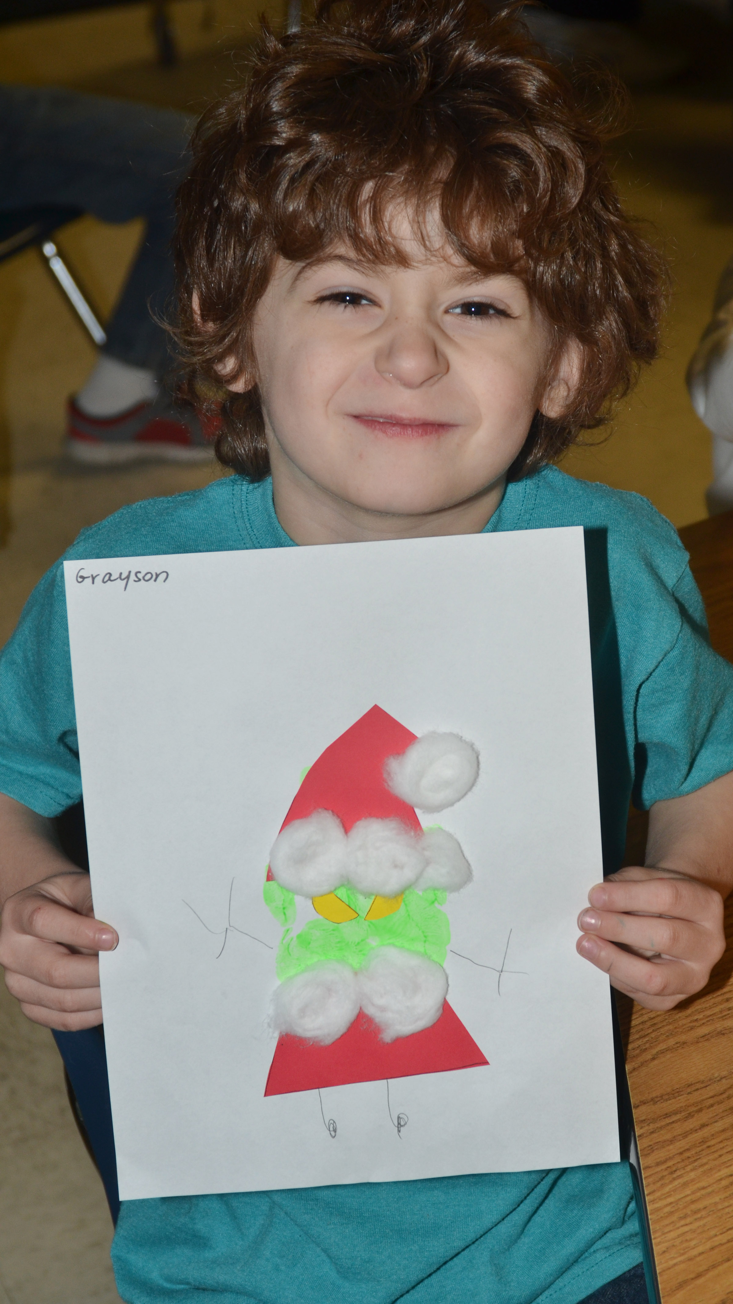 CES kindergartener Greyson Trulock holds the Grinch he made out of his handprint.