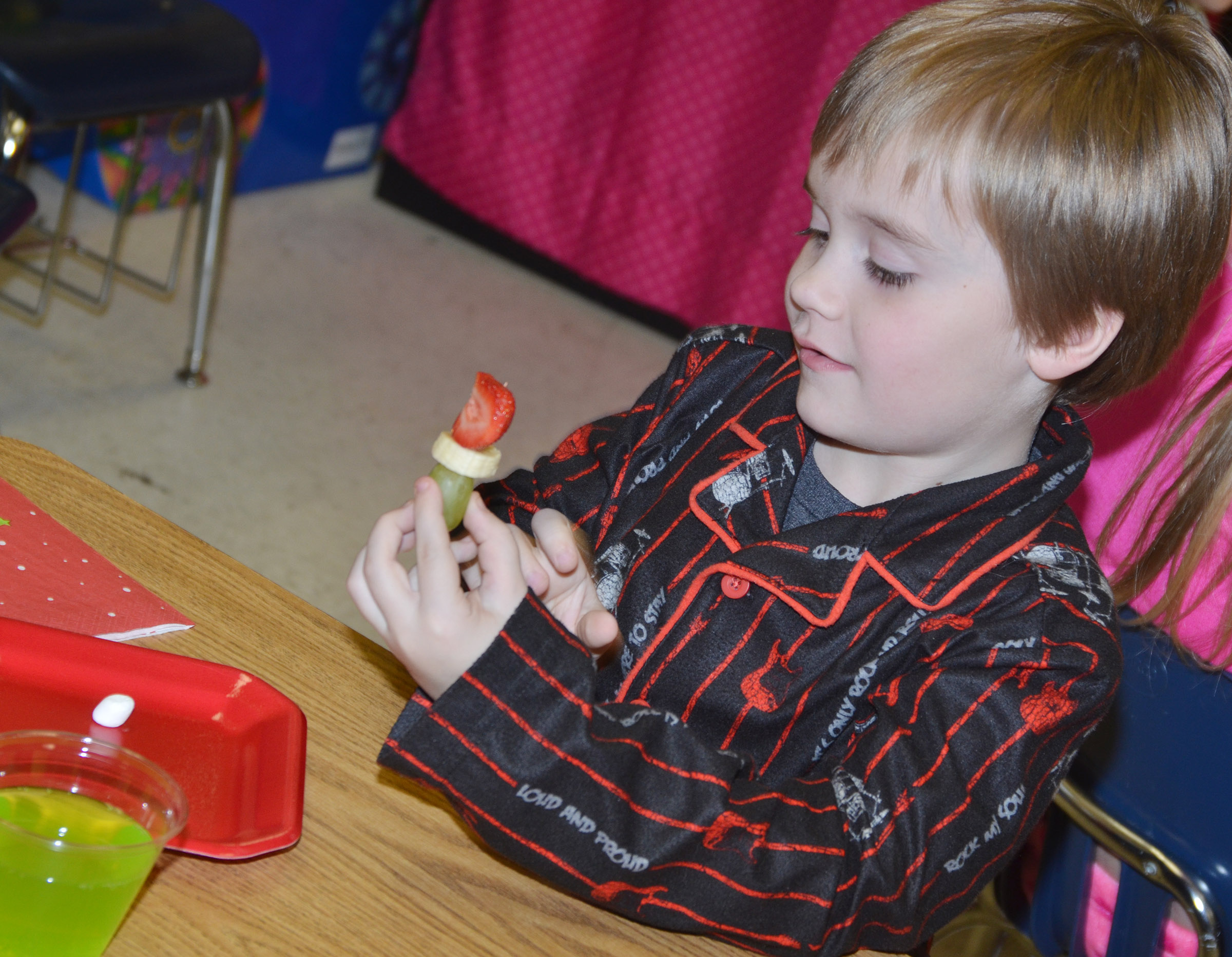 CES kindergartener Gavin Williams makes his Grinch out of fruit.