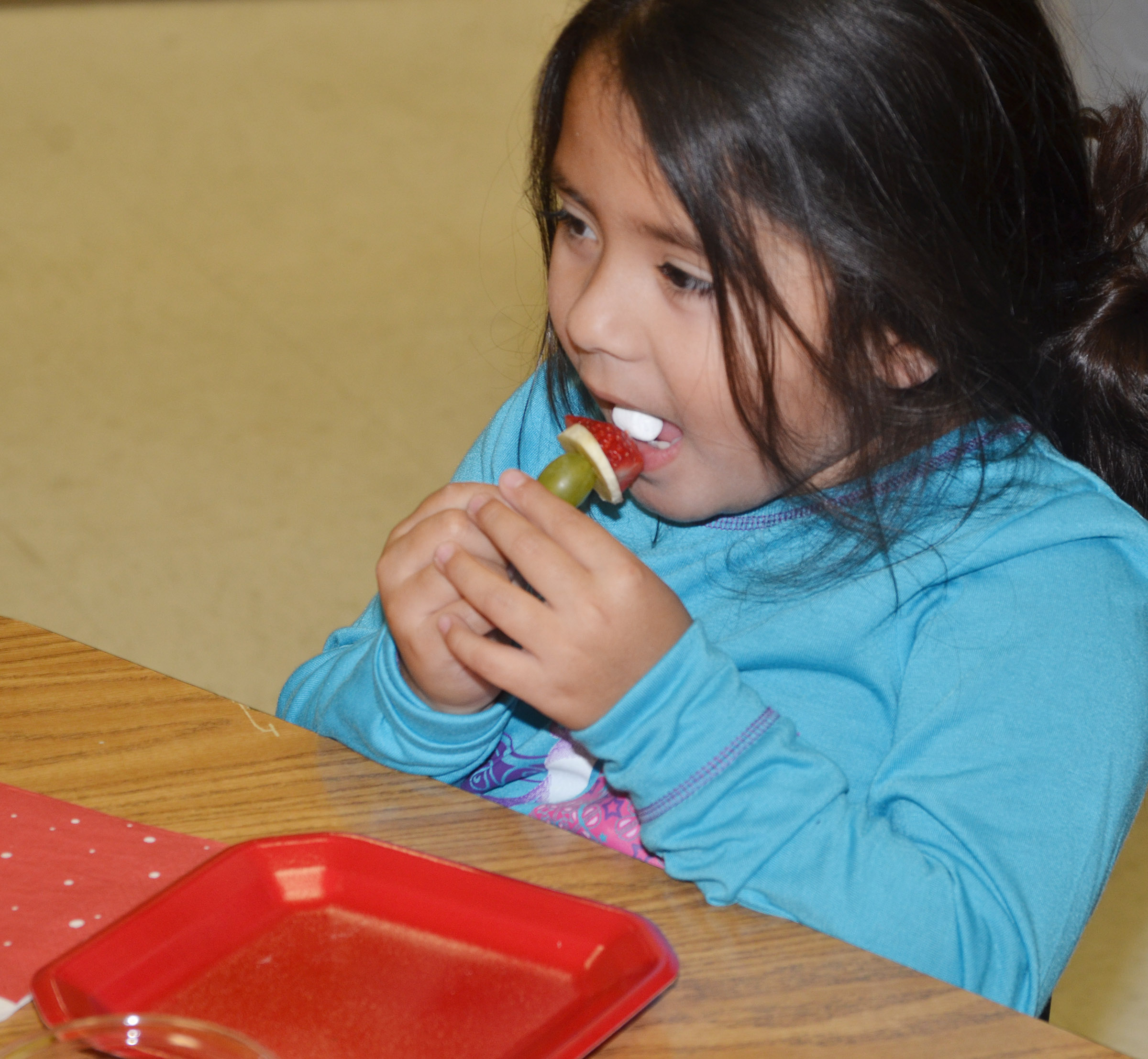 CES kindergartener Juliana Wolford eats her Grinch snack.