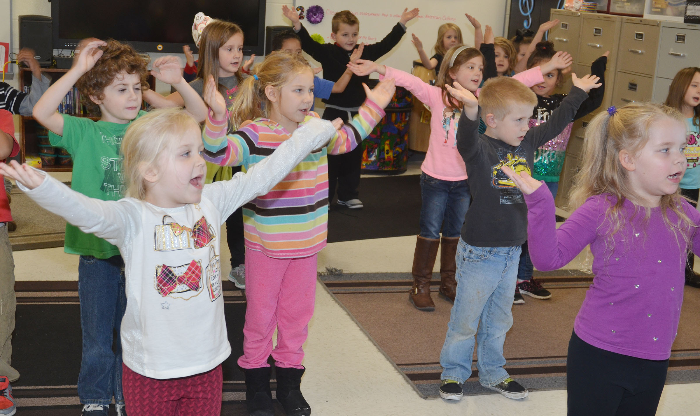 "CES kindergarteners practice their songs and dance moves for their upcoming Christmas musical, entitled ""Bob Humbug, the Christmas Grump."""