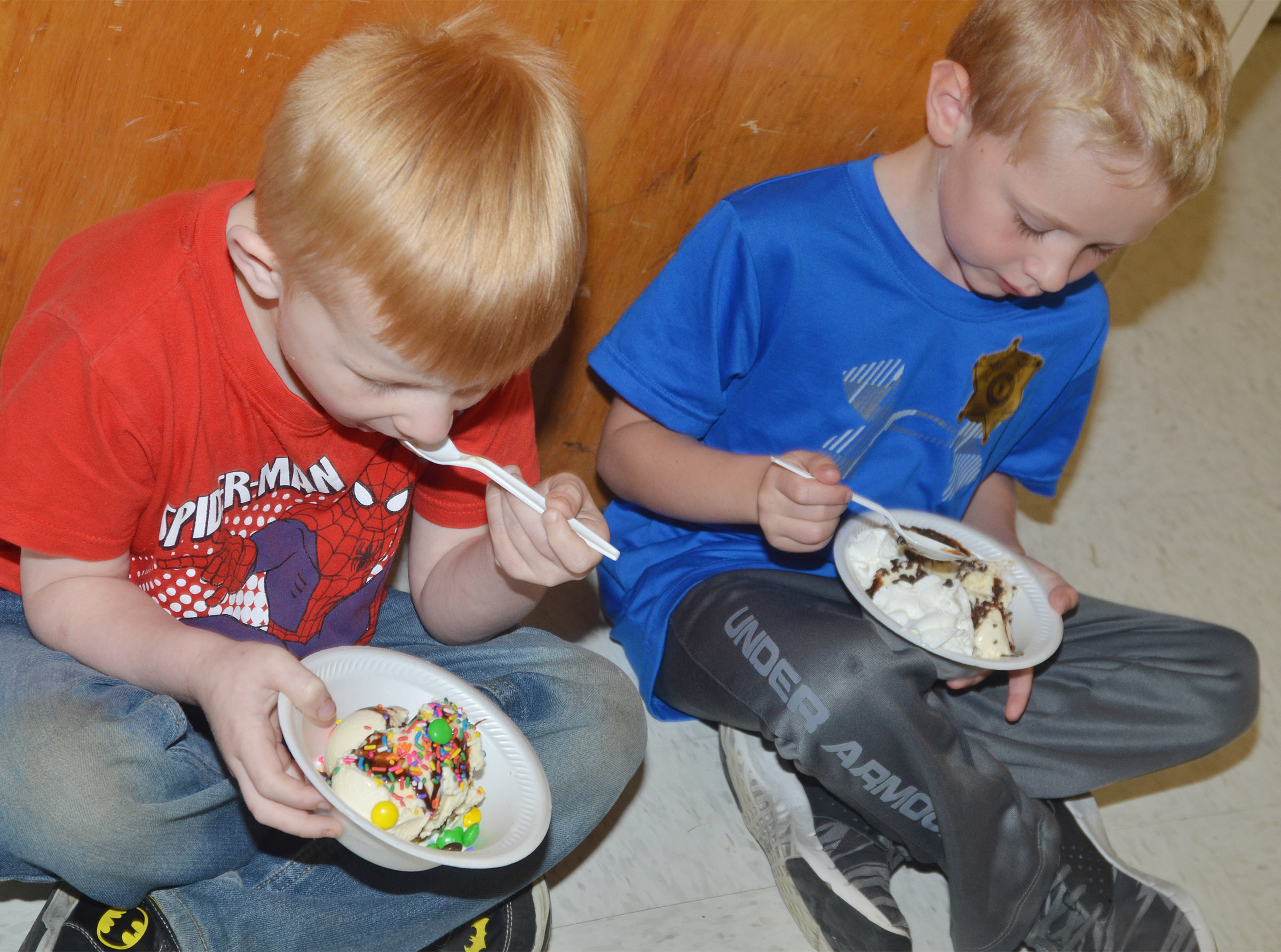 CES kindergarteners Jayden Maupin, at left, and Jackson Wright enjoy their ice cream sundaes.