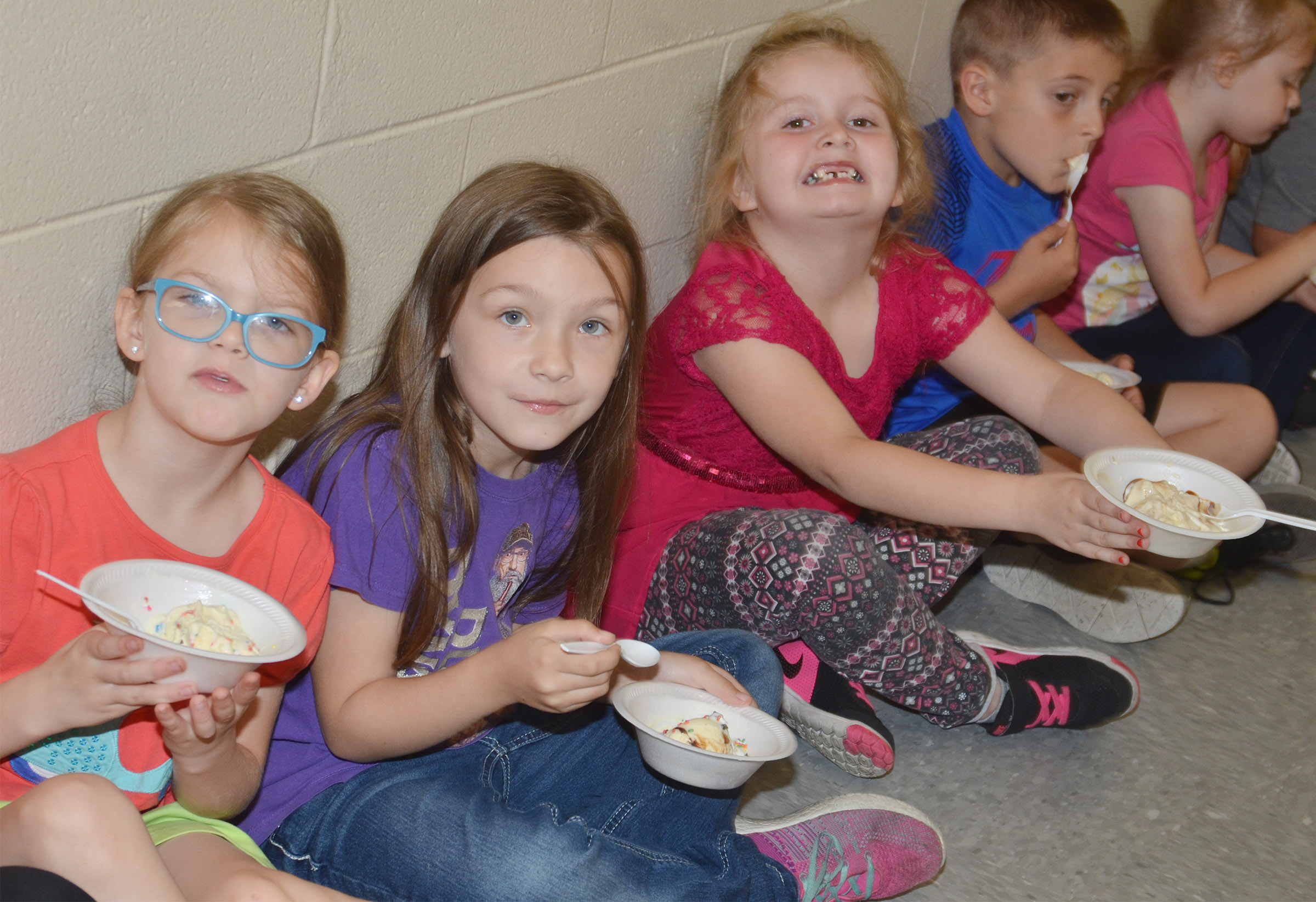 From left, CES kindergarteners Zoe Weddle, Melody Ward and Laurna McKenzie enjoy their ice cream sundaes.