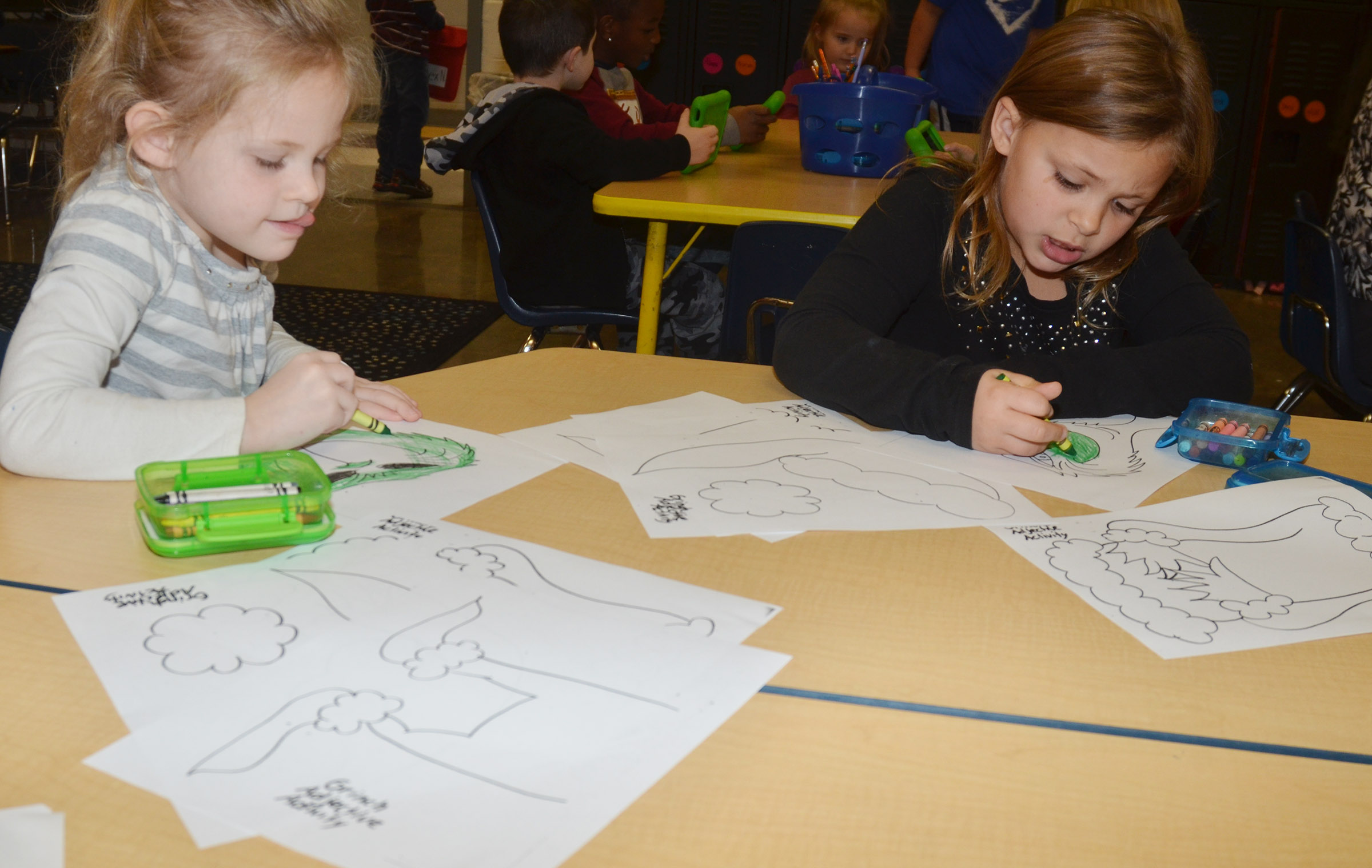 CES kindergarteners Riley Bright, at left, and Alaziah Smith color the Grinch.