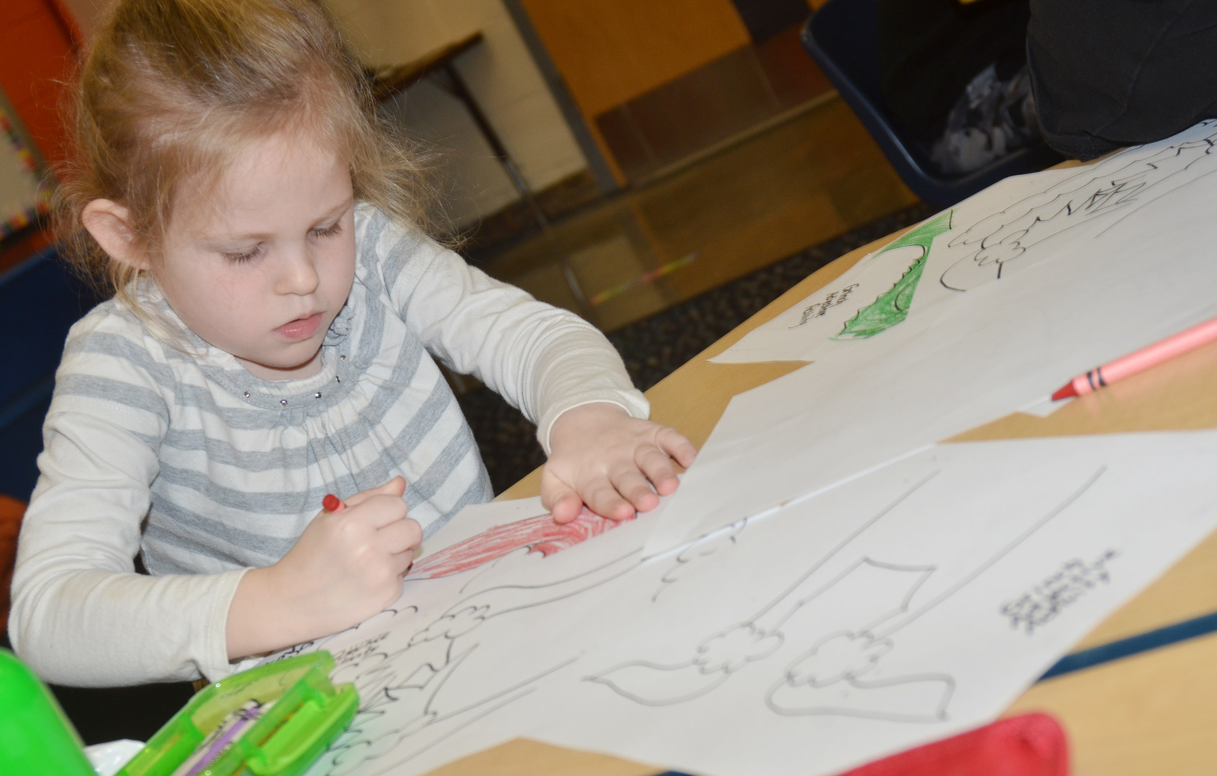CES kindergartener Riley Bright colors the Grinch.