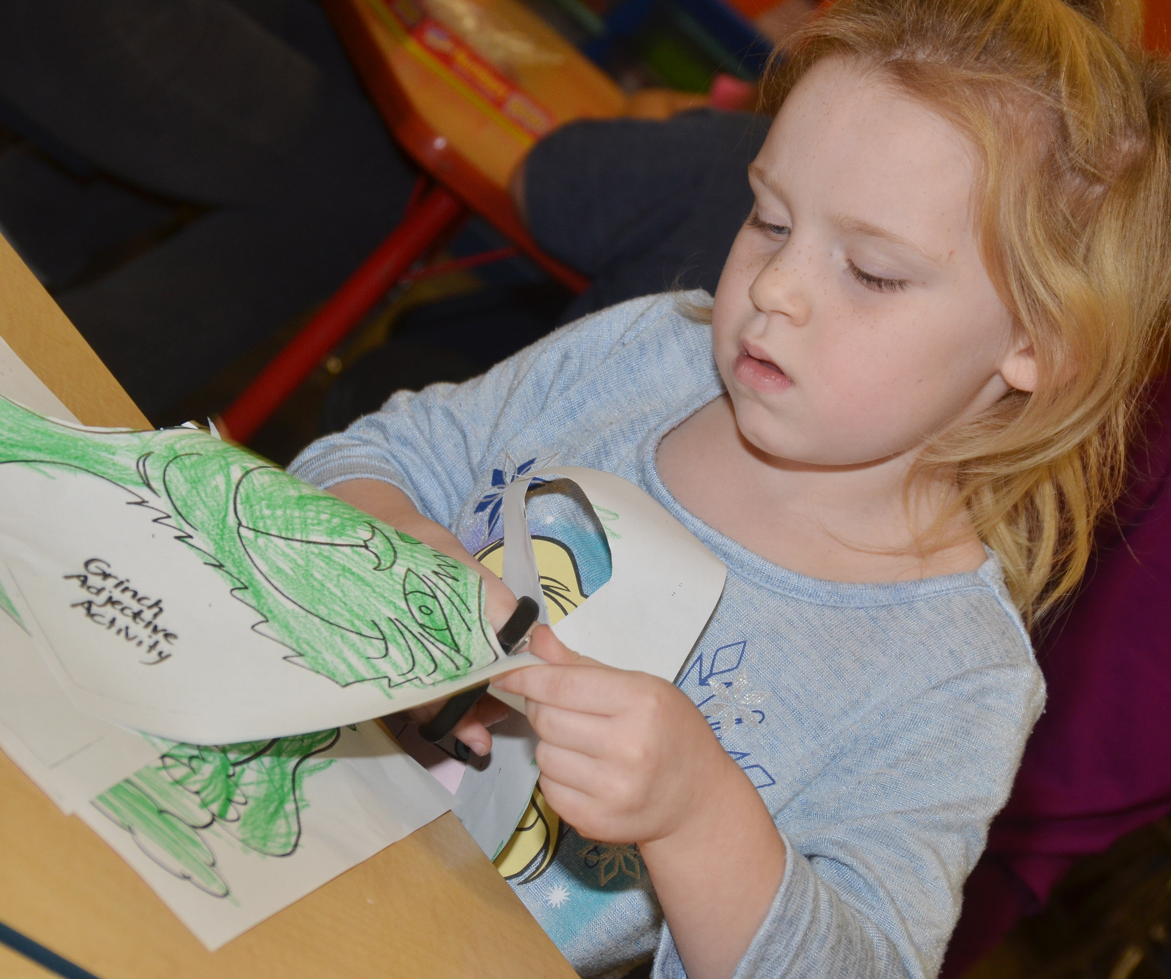 CES kindergartener Macilynn Mann colors the Grinch.
