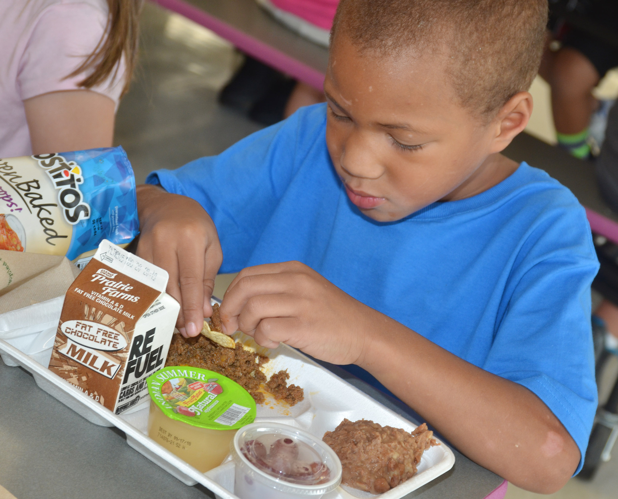 CES kindergartener Jamerius Miller eats his tacos.