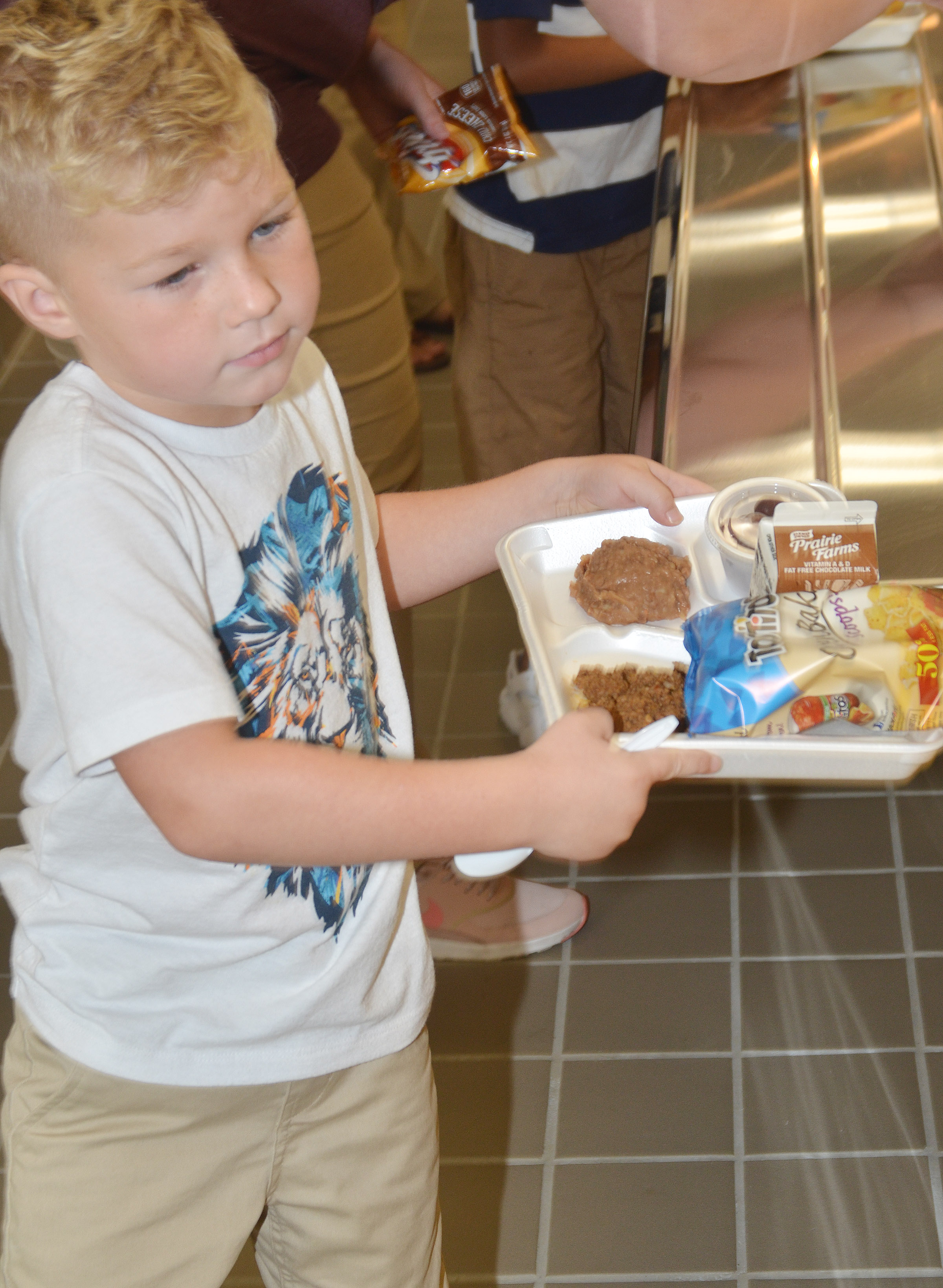 CES kindergartener Landry Brown carries his lunch tray.