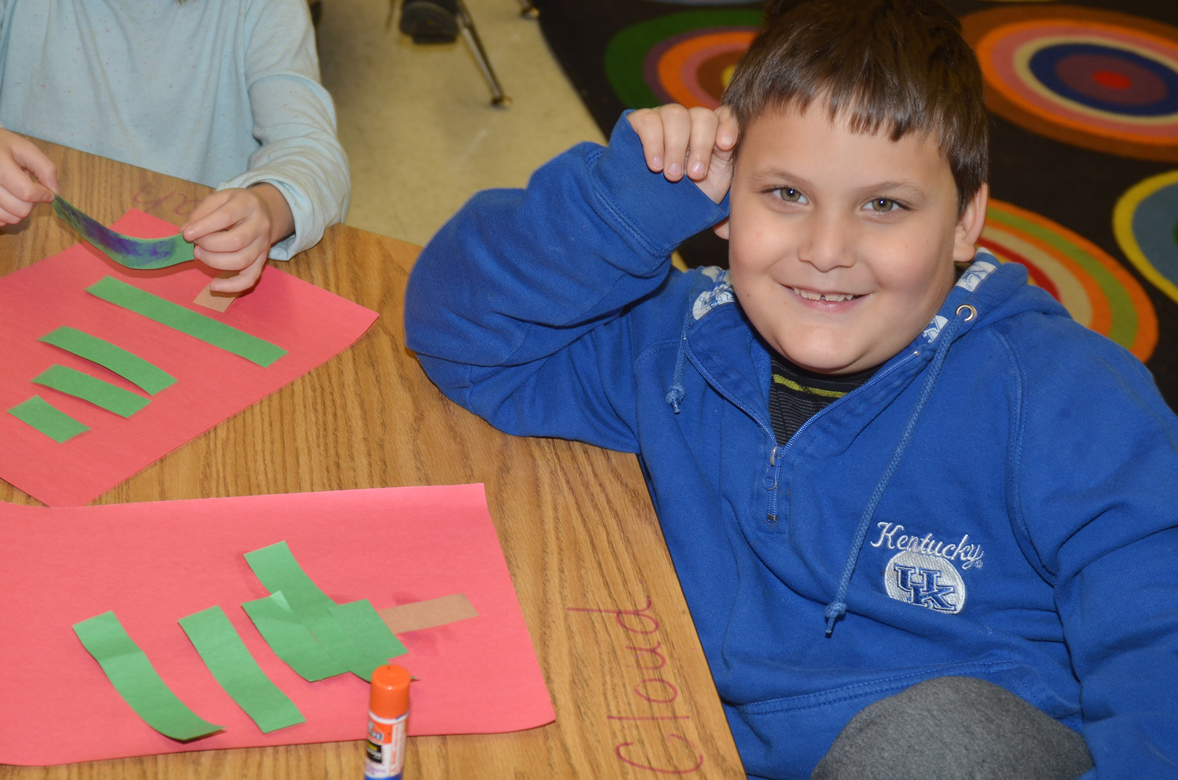 CES kindergartener Cloud Malone glues his Christmas tree together.