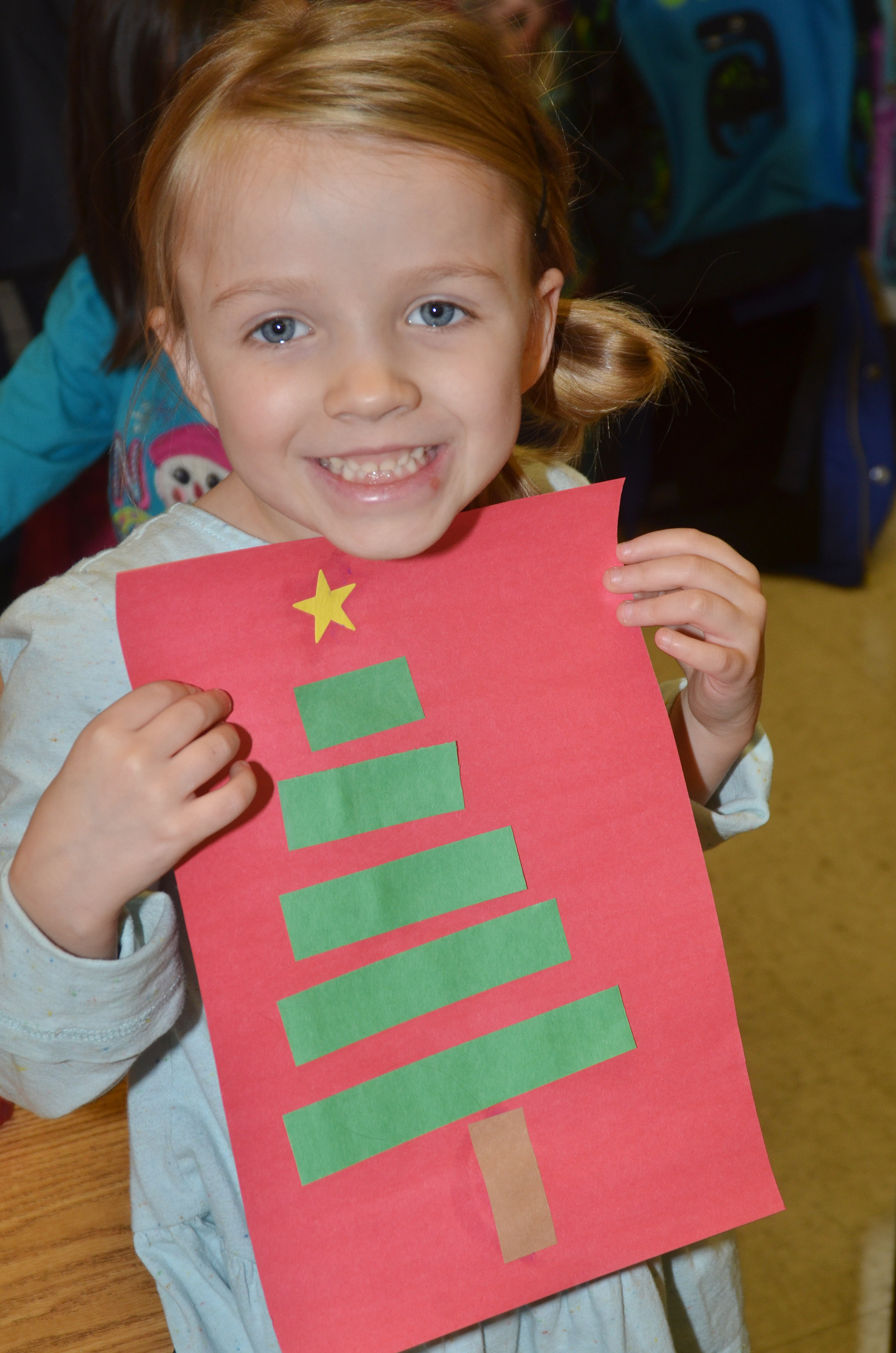 CES kindergartener Leah Covey holds her finished Christmas tree.