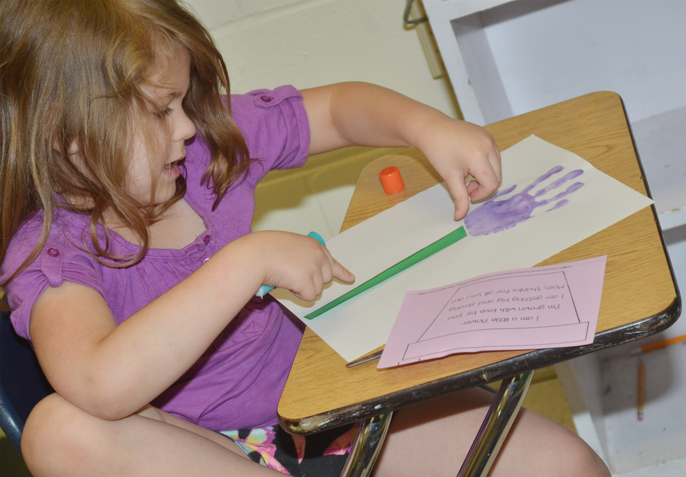 CES kindergartener Aubrey Wilson makes her Mother's Day flower.
