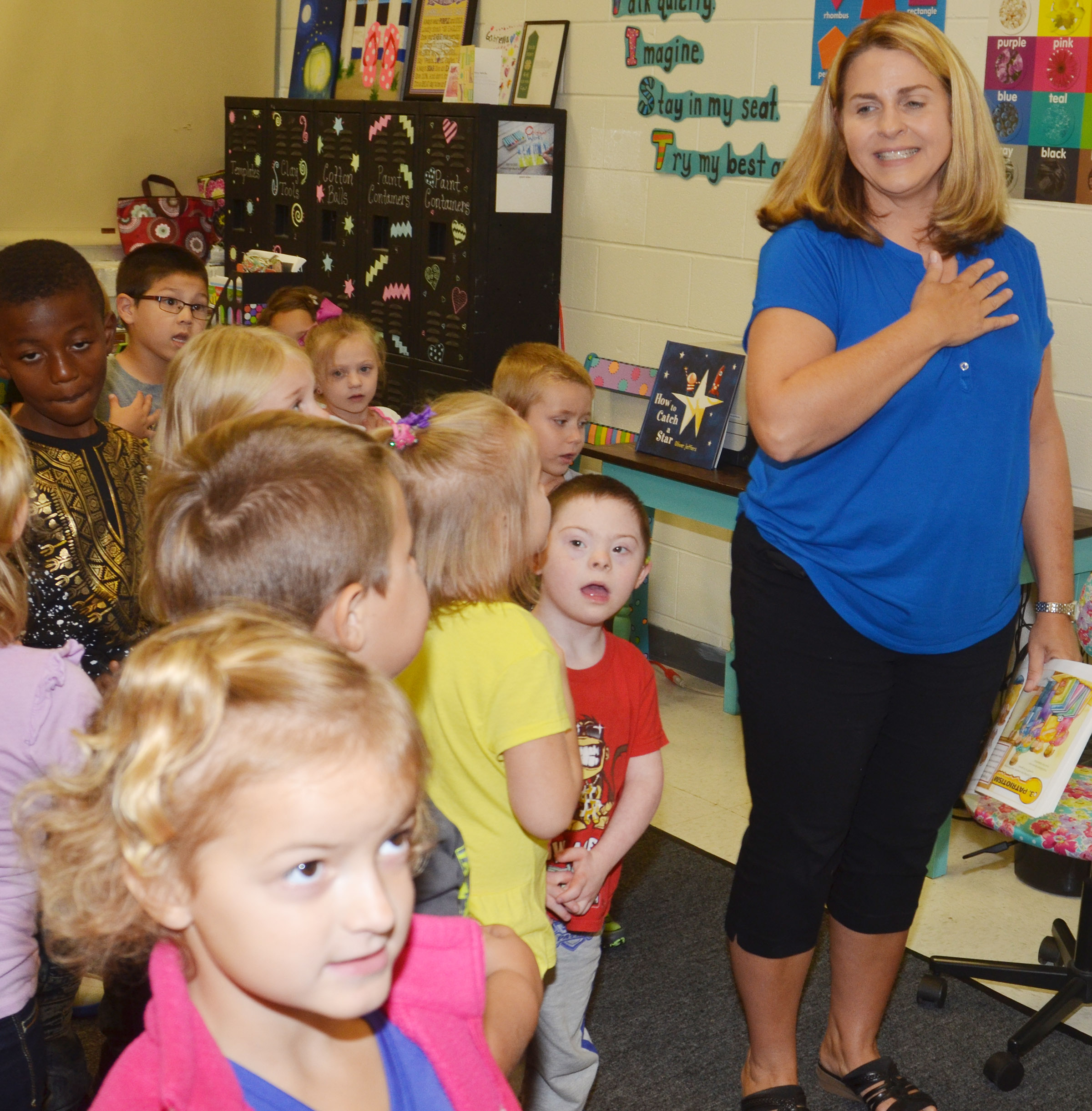 CES Guidance Counselor Sonya Orberson talks to kindergarten students about being patriotic.