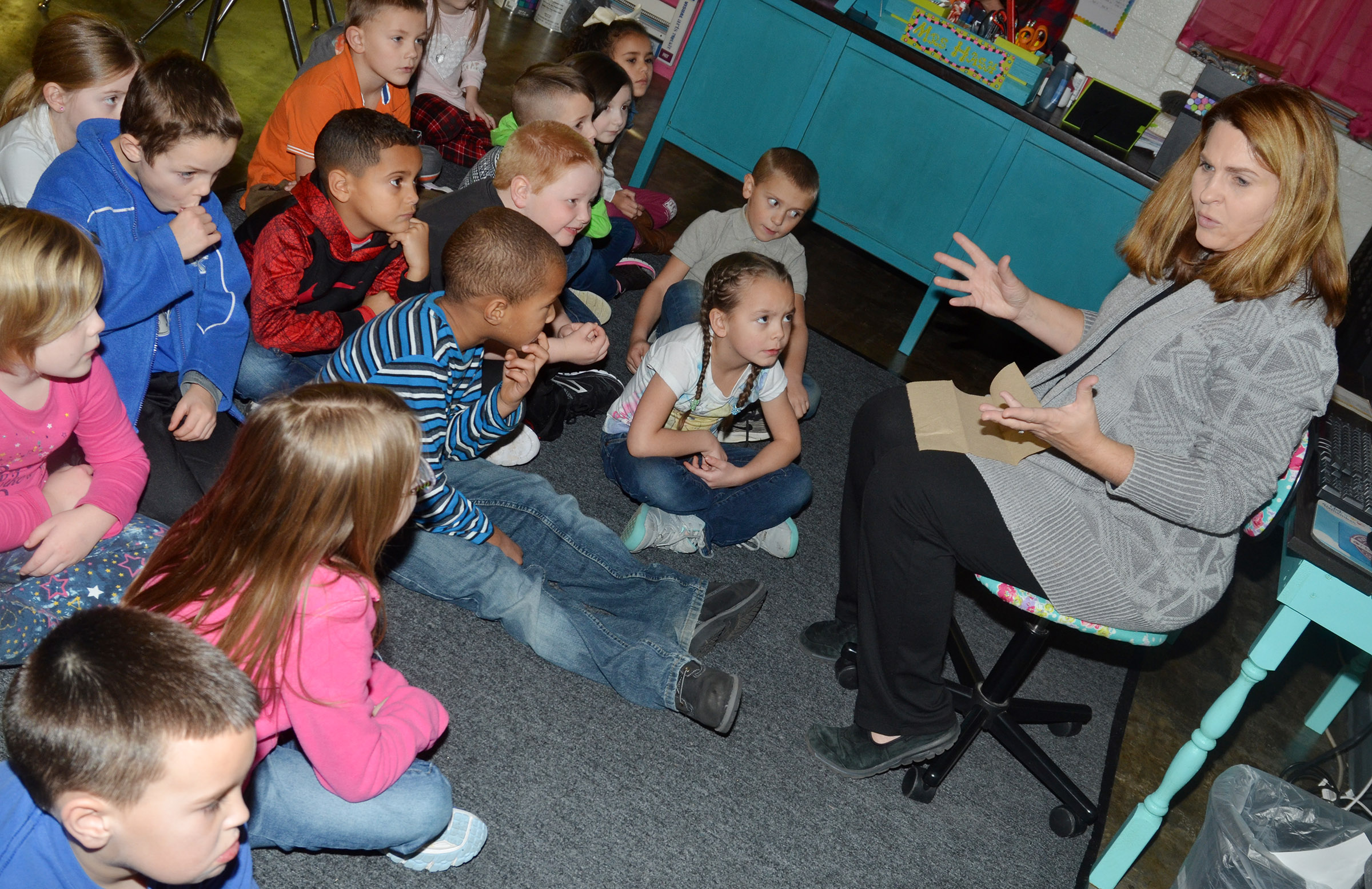 CES Guidance Counselor Sonya Orberson talks to kindergarten students about why it's important to have good table manners.