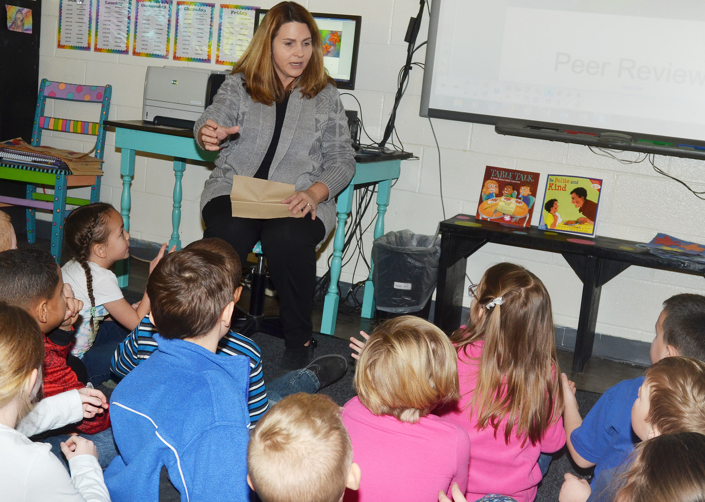 CES Guidance Counselor Sonya Orberson talks to kindergarten students about the proper way to behave when eating.