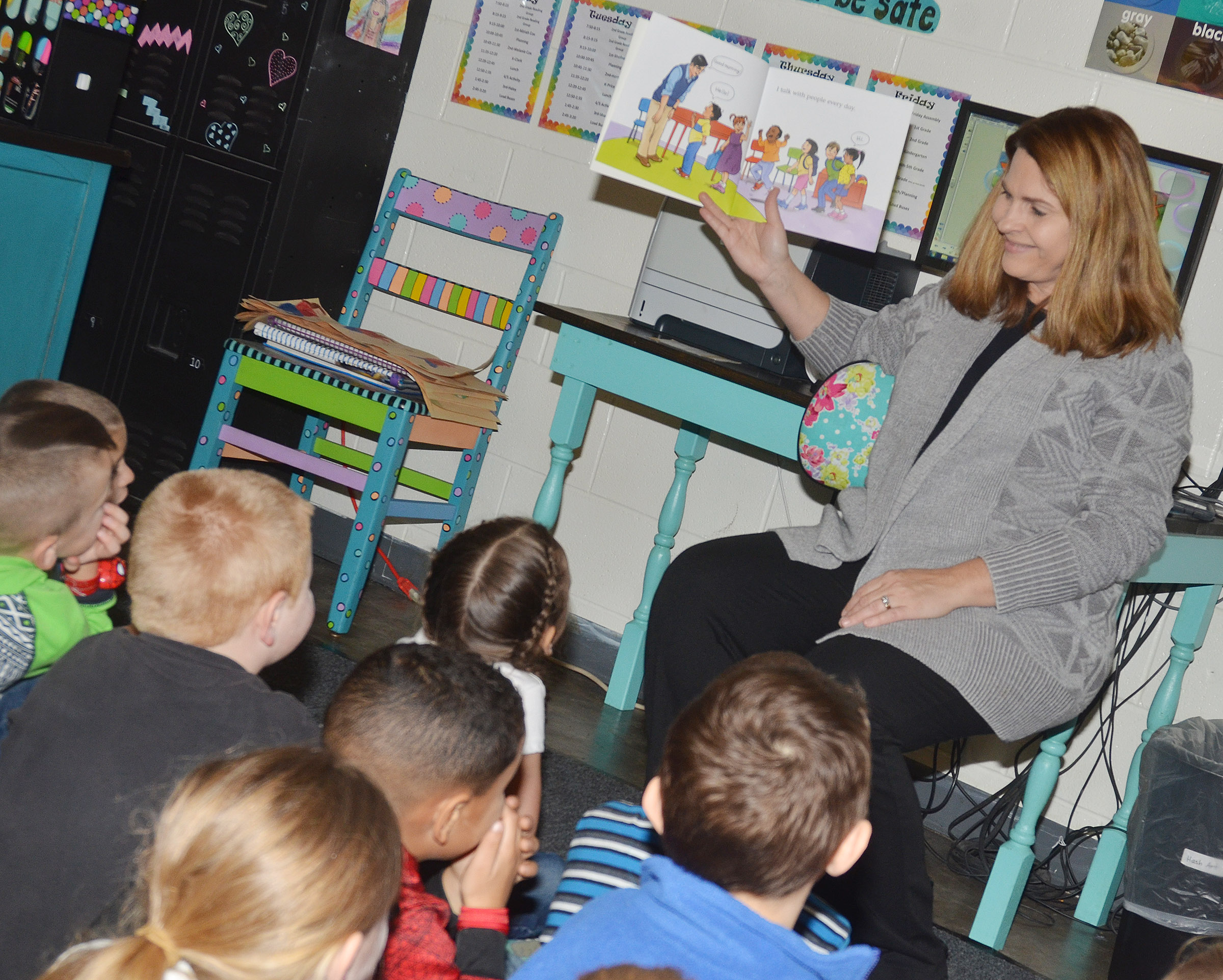 CES Guidance Counselor Sonya Orberson reads to kindergarten students about being polite.