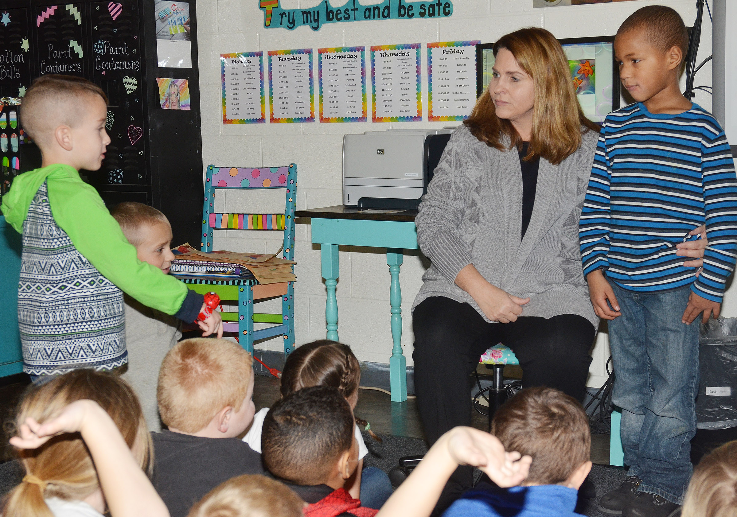 CES Guidance Counselor Sonya Orberson talks to kindergarteners Cash Davis, at left, and Jamerius Miller about the importance of being polite and kind with each other.