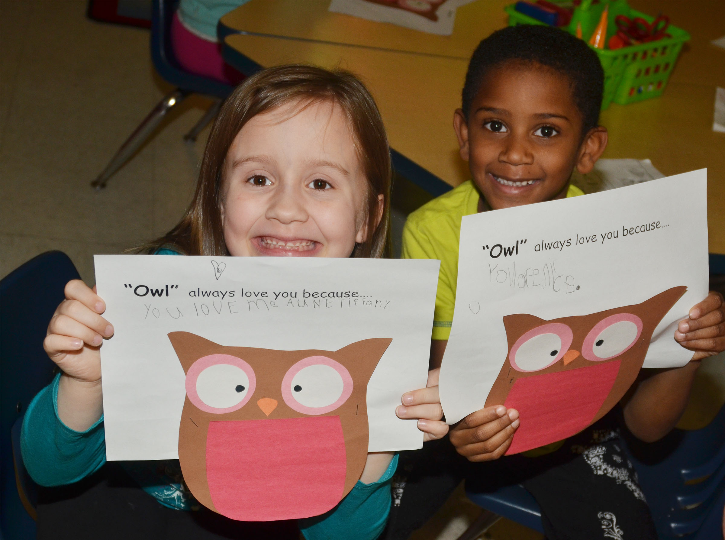 CES kindergarteners Natalee Shaw, at left, and Kasen Smith hold their owls.