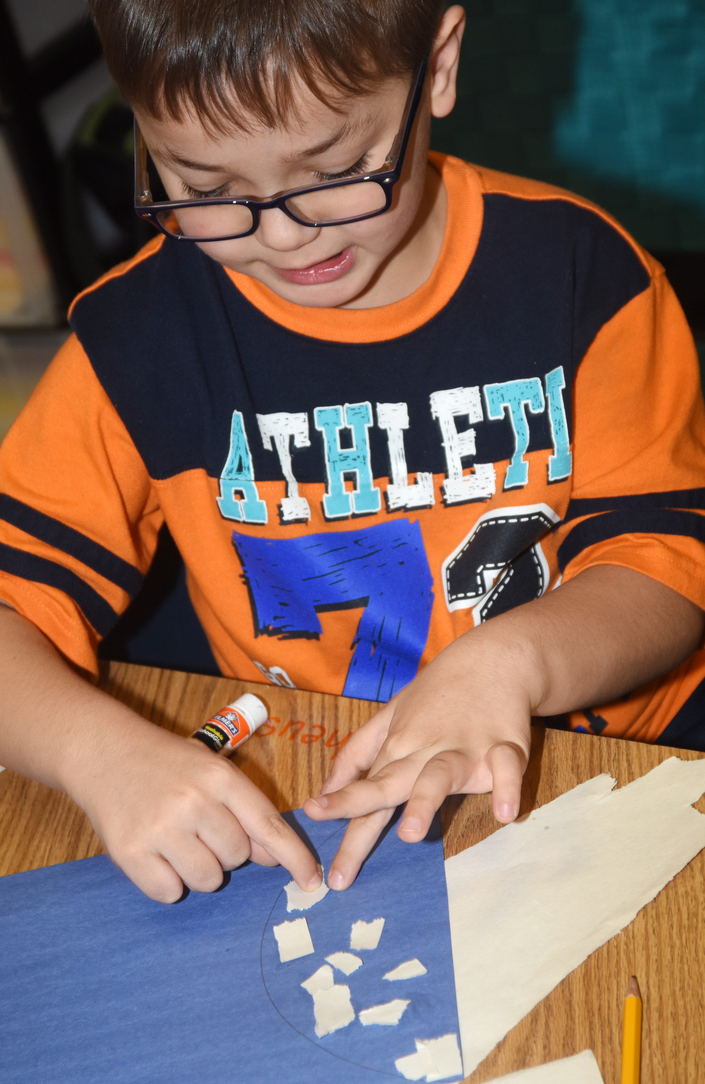 CES kindergartener Matheus Almeida glues together construction paper to make his snowman.