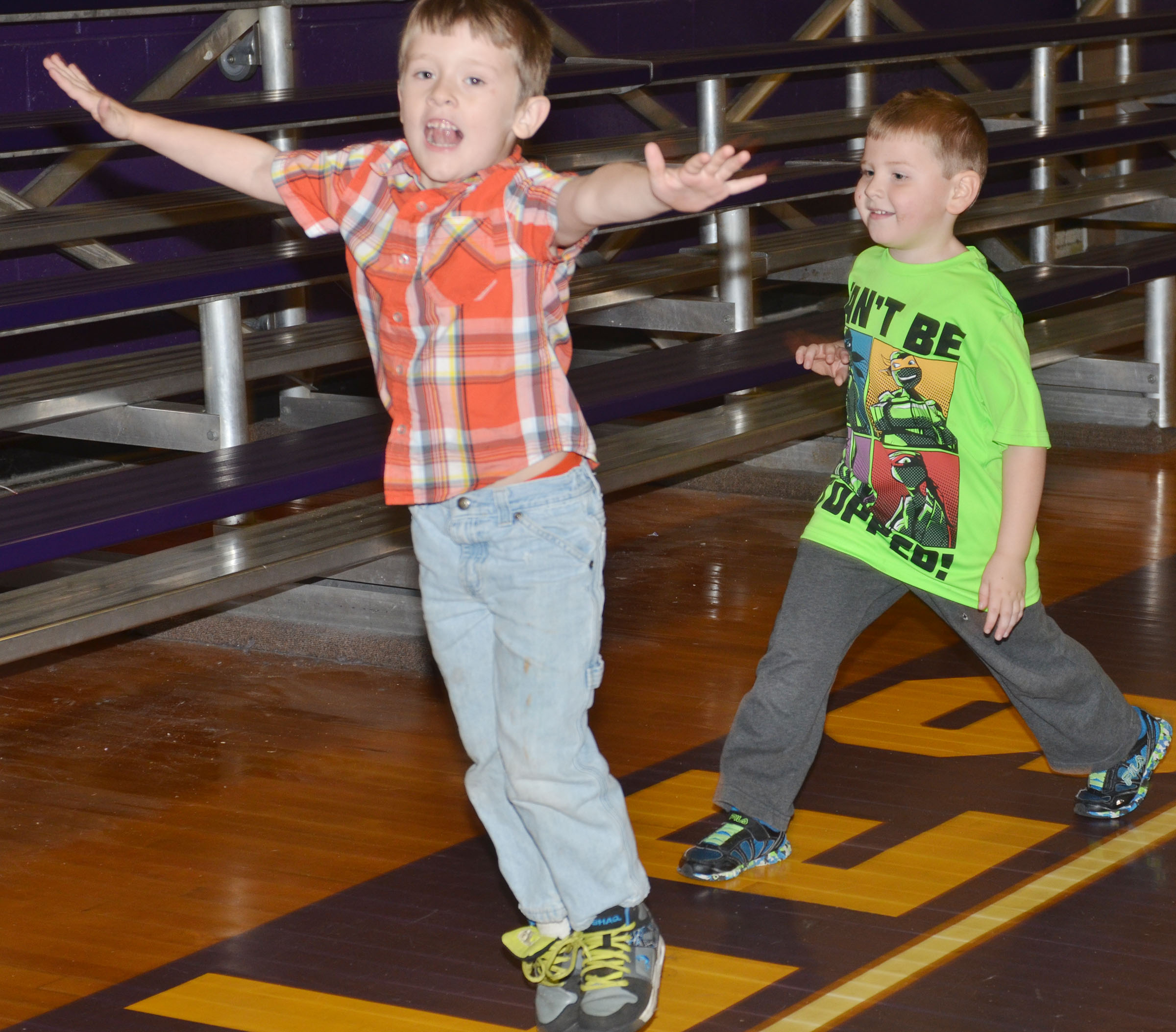 CES kindergartener Conor Gayheart, at left, and Enrique McDonald walk laps before they practice their dribbling.