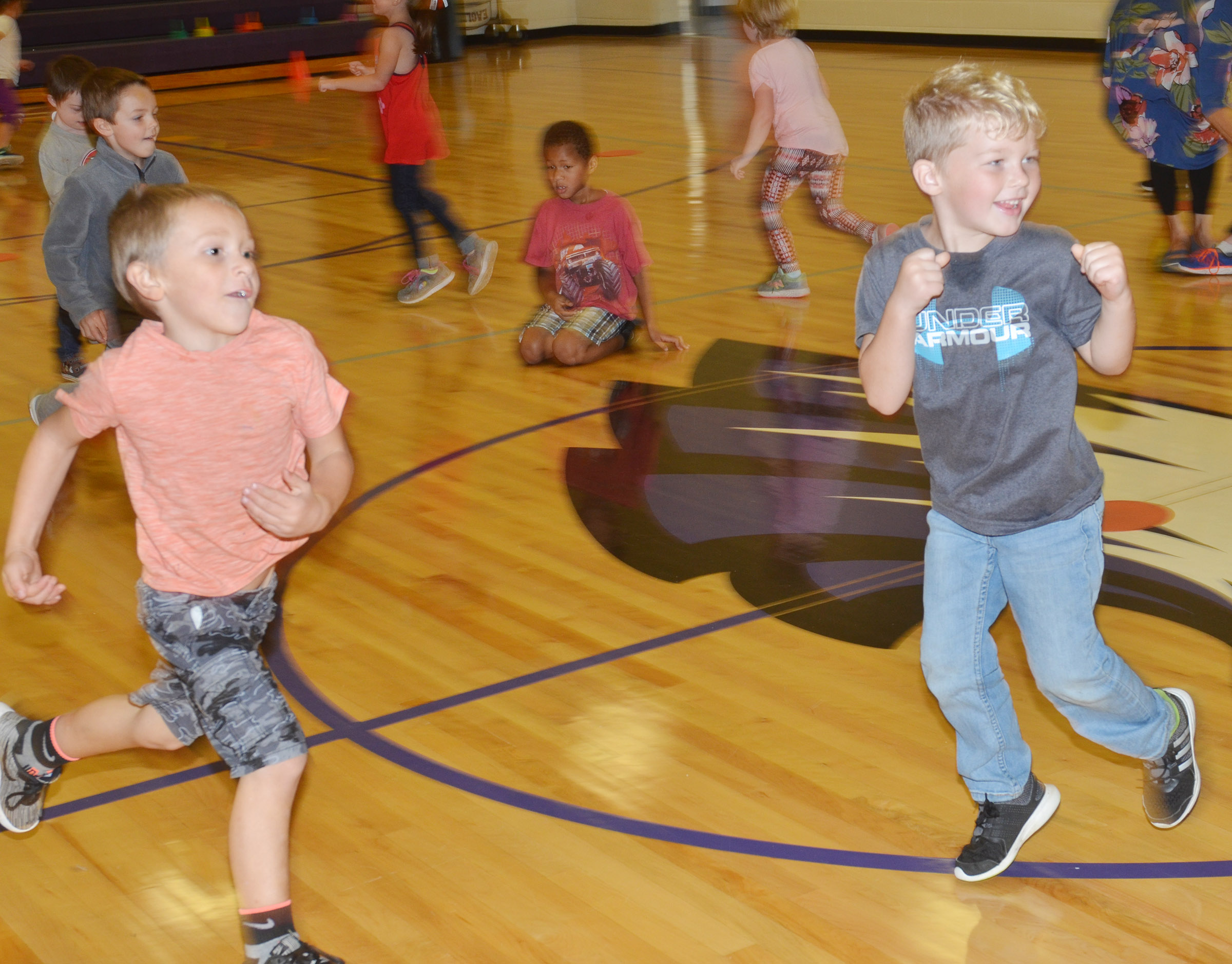 CES kindergarteners Dawson Morton, at left, and Landry Brown run.