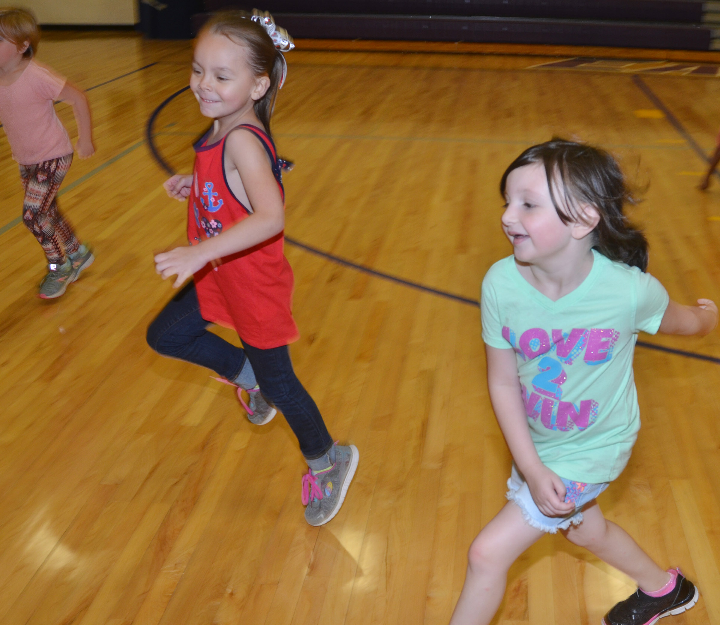CES kindergarteners Kalie Pilkington, at left, and Abigail Smith run.