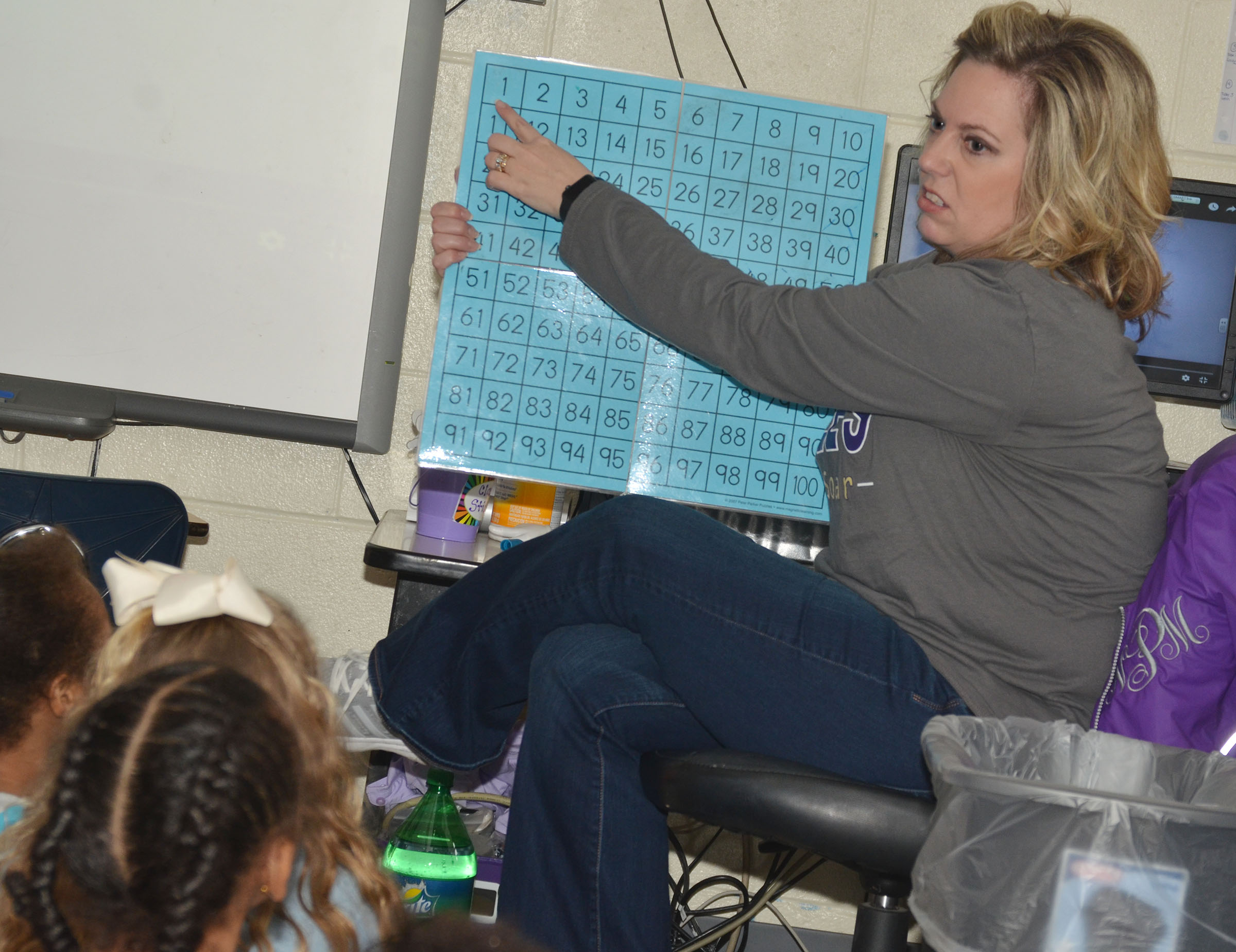 CES kindergartener teacher Niki Price counts to 100 with her students.