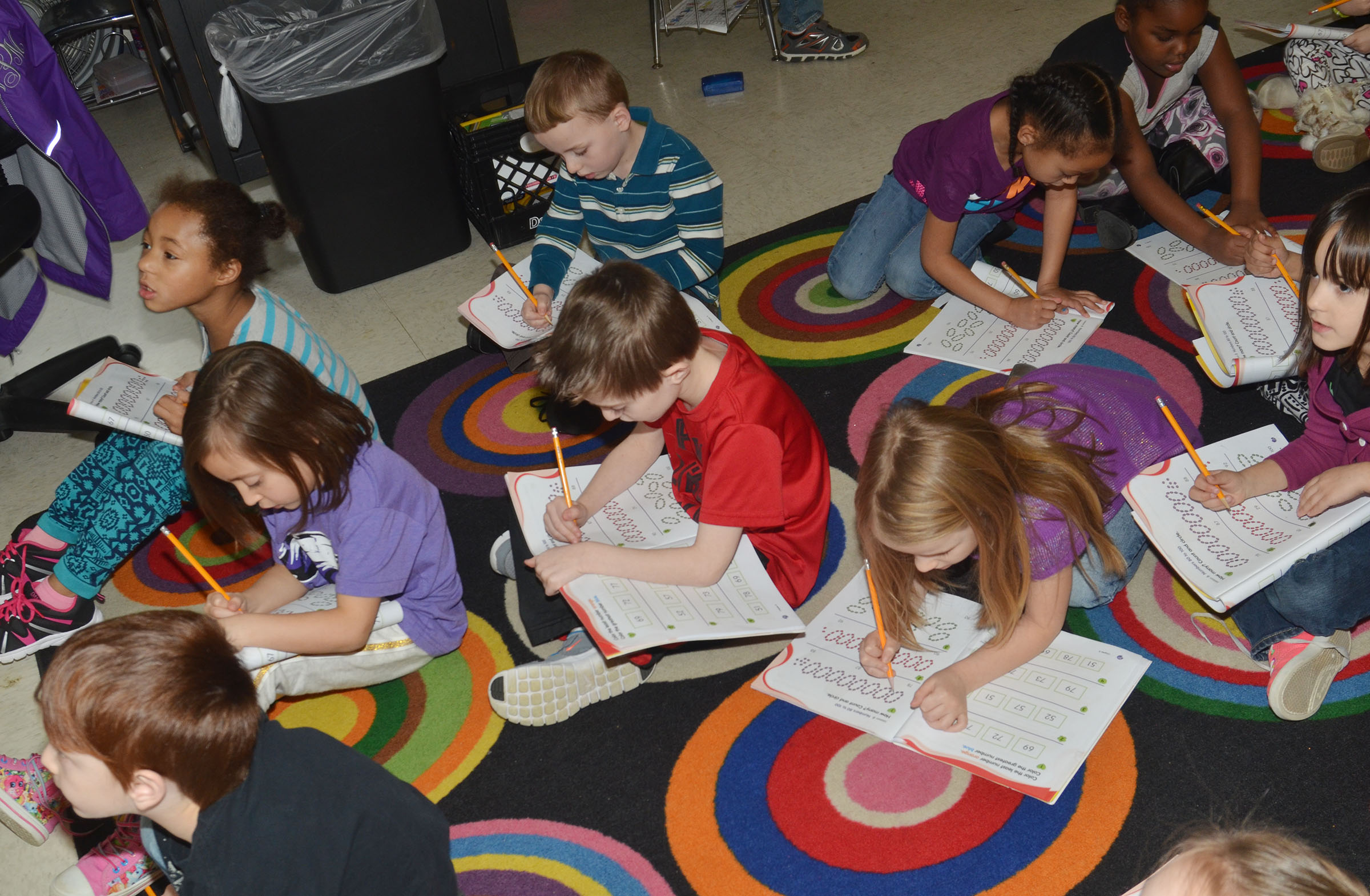 CES kindergarteners work in their math books.