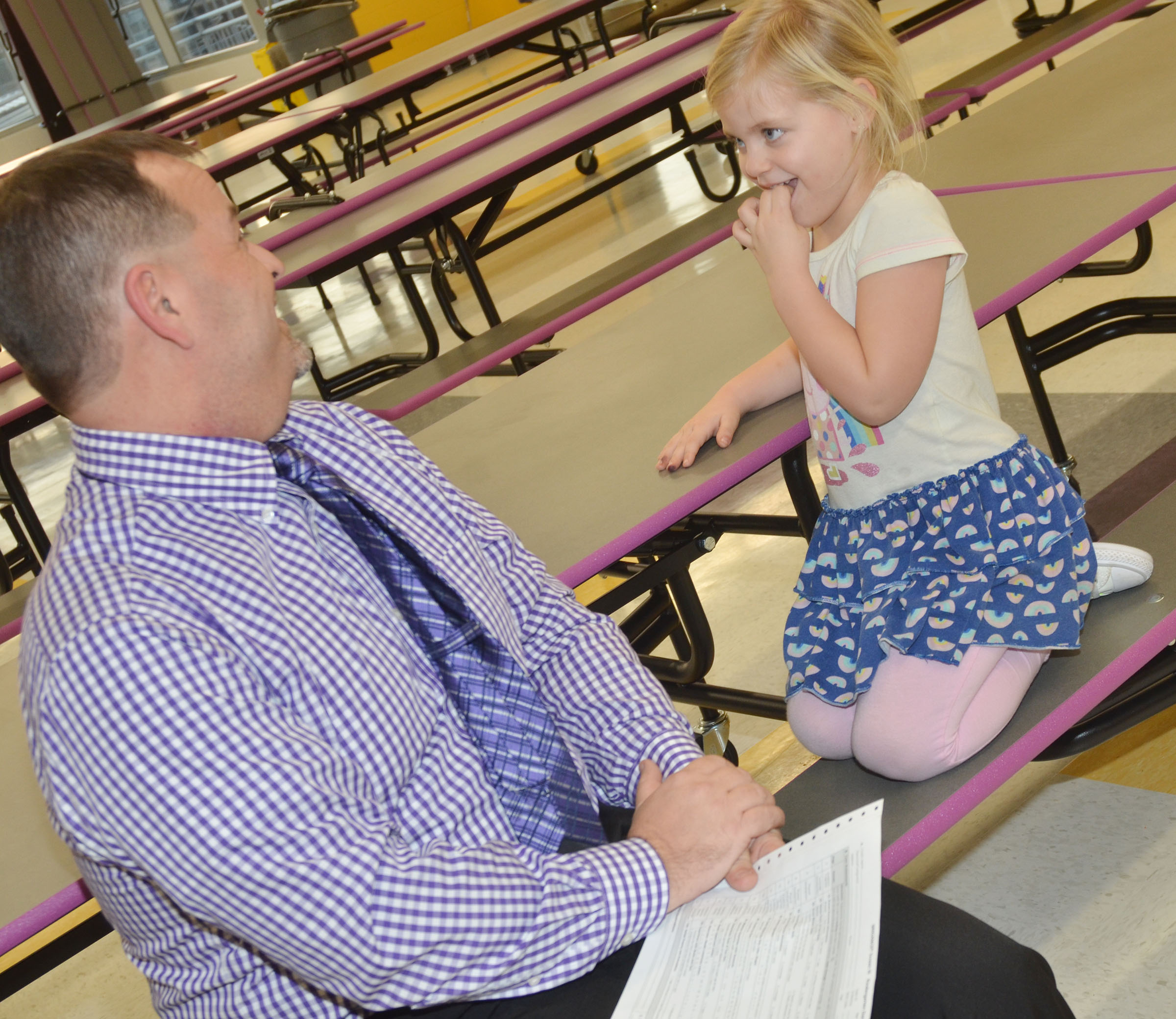 CES Principal Ricky Hunt asks Remi Petett some questions to see if she is ready to begin kindergarten next year.