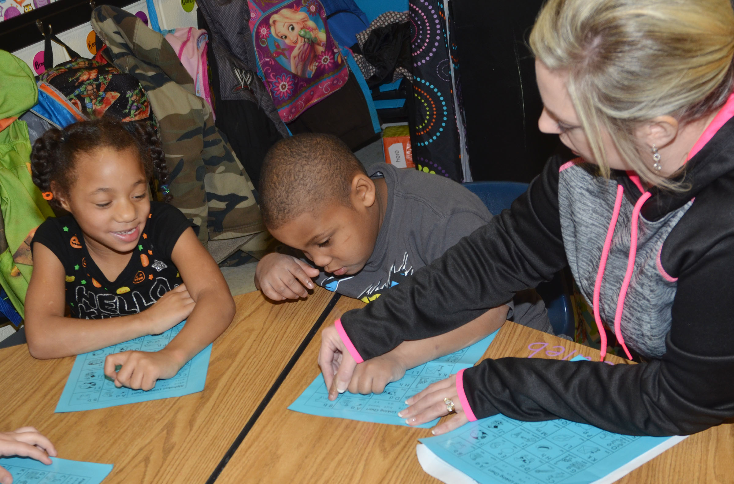 CES kindergarten teacher Nikki Price recites the alphabet with students Brea Miller, at left, and Malachi Conner.