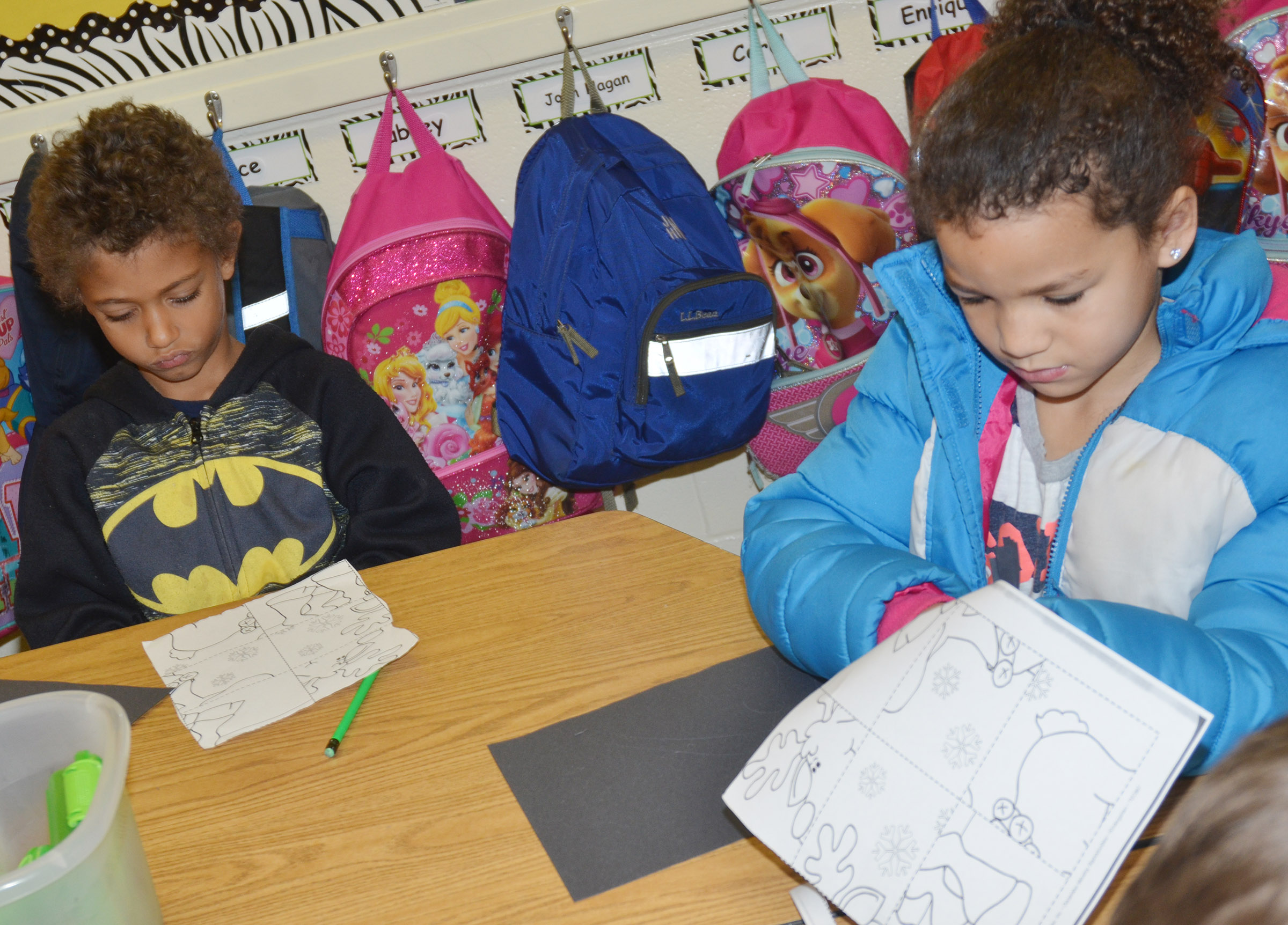 CES kindergarteners Tyce Owens, at left, and Aleeya Spaulding cut out their puzzles.