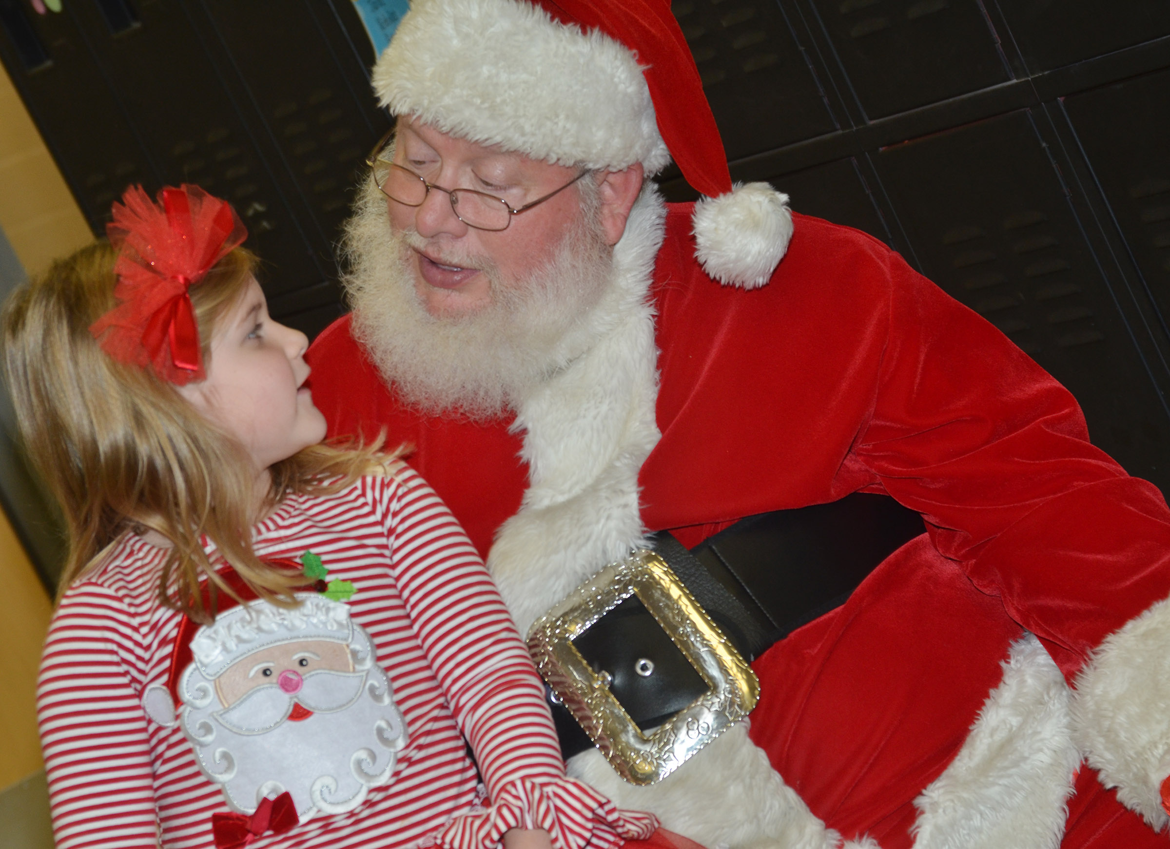 Santa tells CES kindergartner Aubreigh Knifley that he likes her outfit.