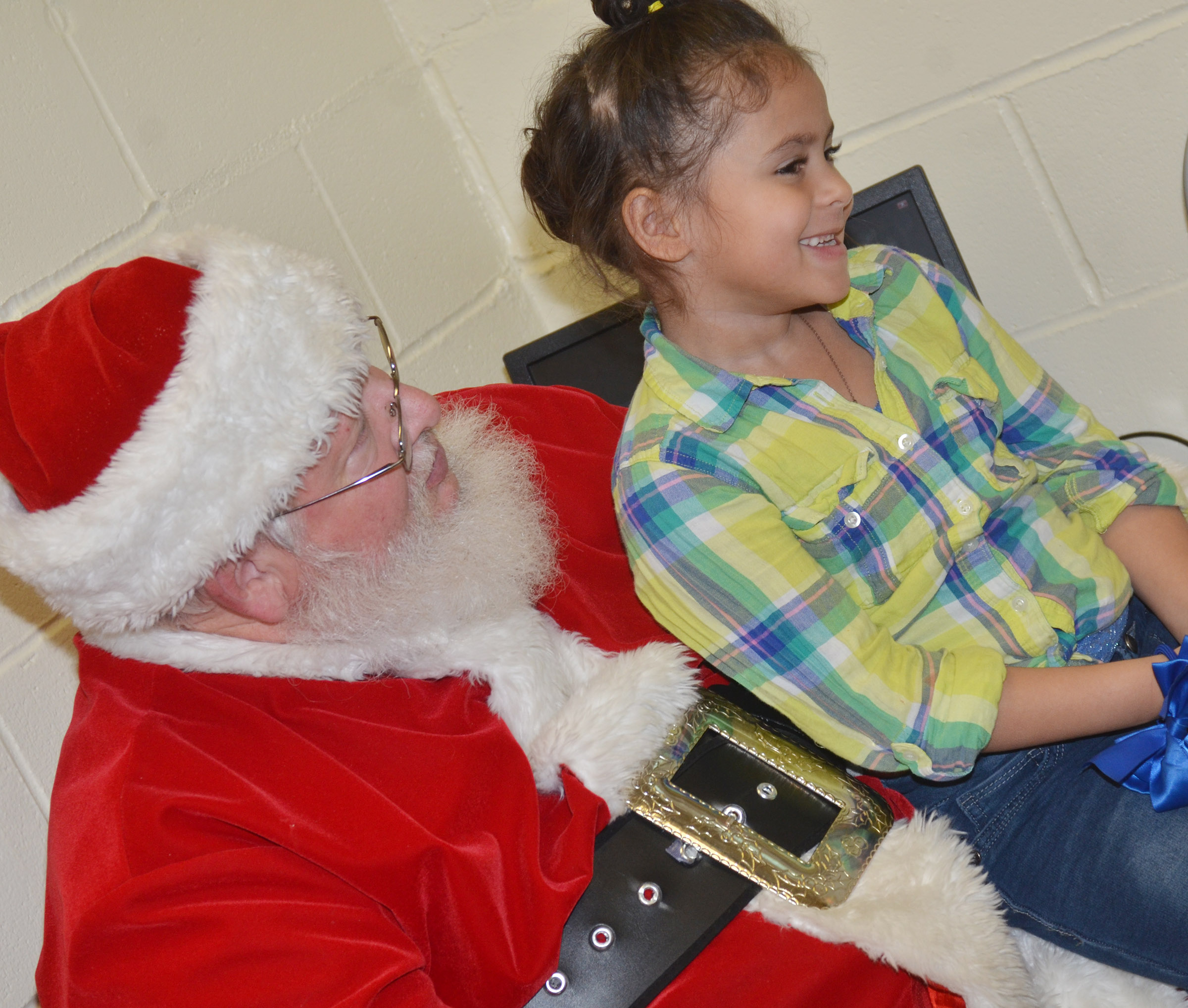 CES kindergartener Isabella Anderson smiles as Santa asks her if she's been good.