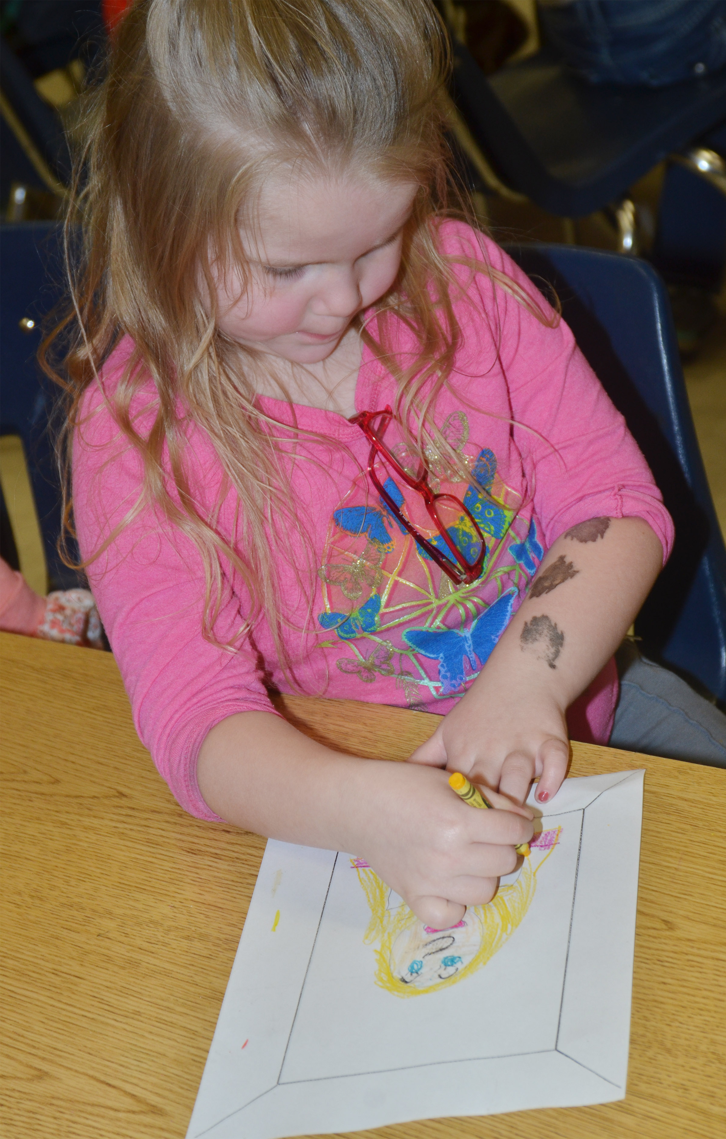CES kindergartener Cera Rooker colors her self-portrait.
