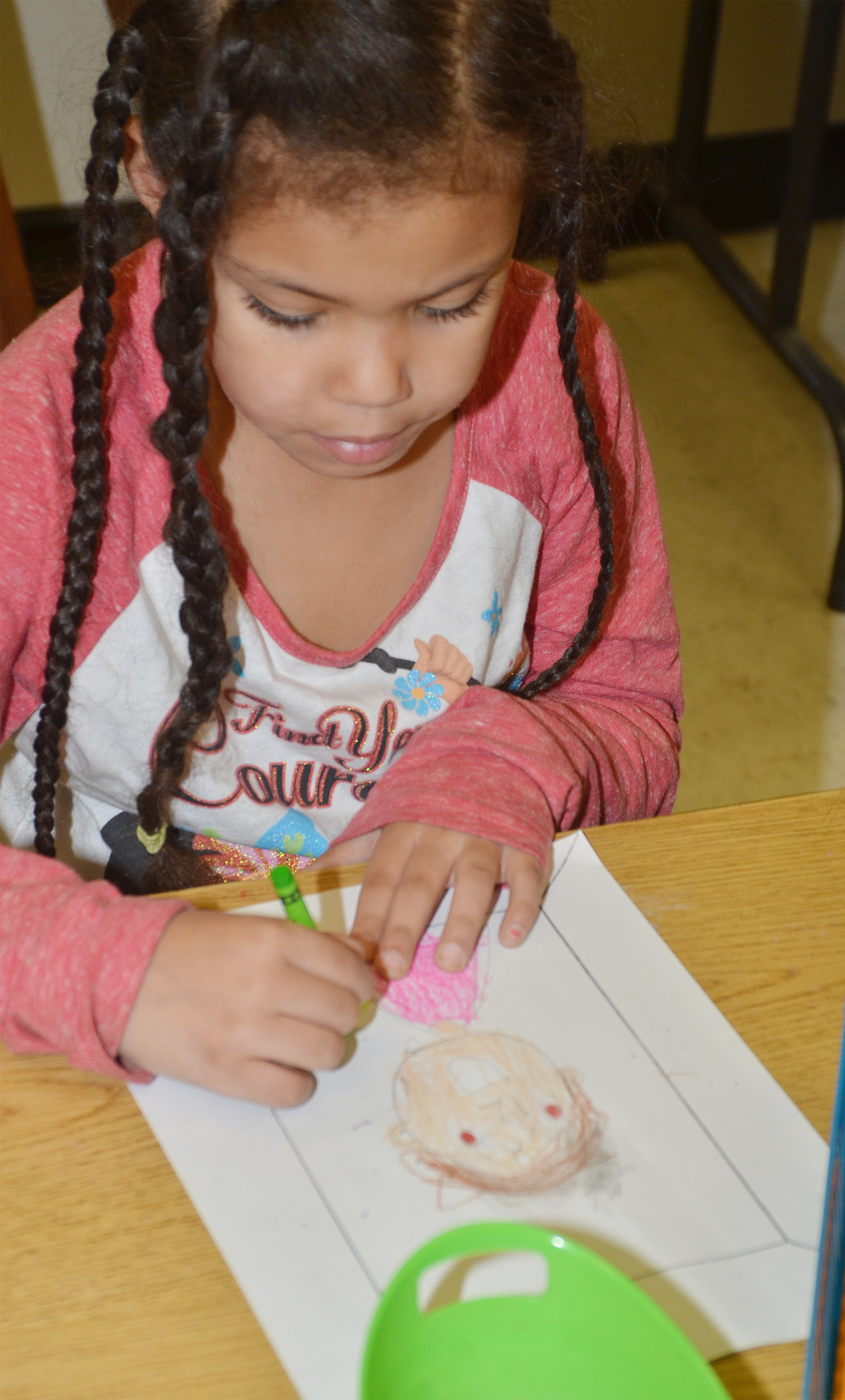 CES kindergartener Jasymon Musselwhite colors her self-portrait.