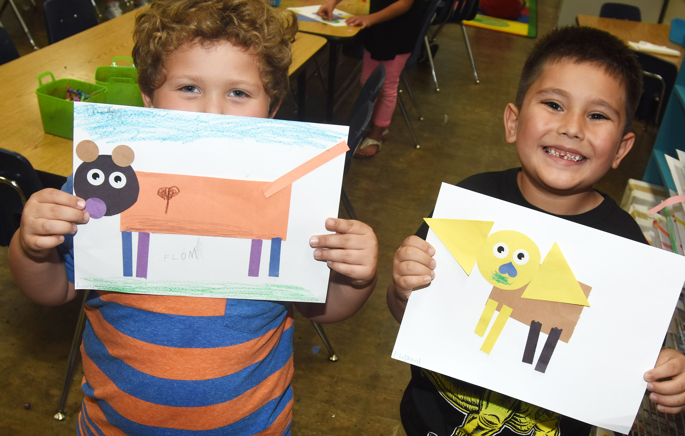 CES kindergarteners XXX, at left, and XXX hold their lion and elephant, respectively.