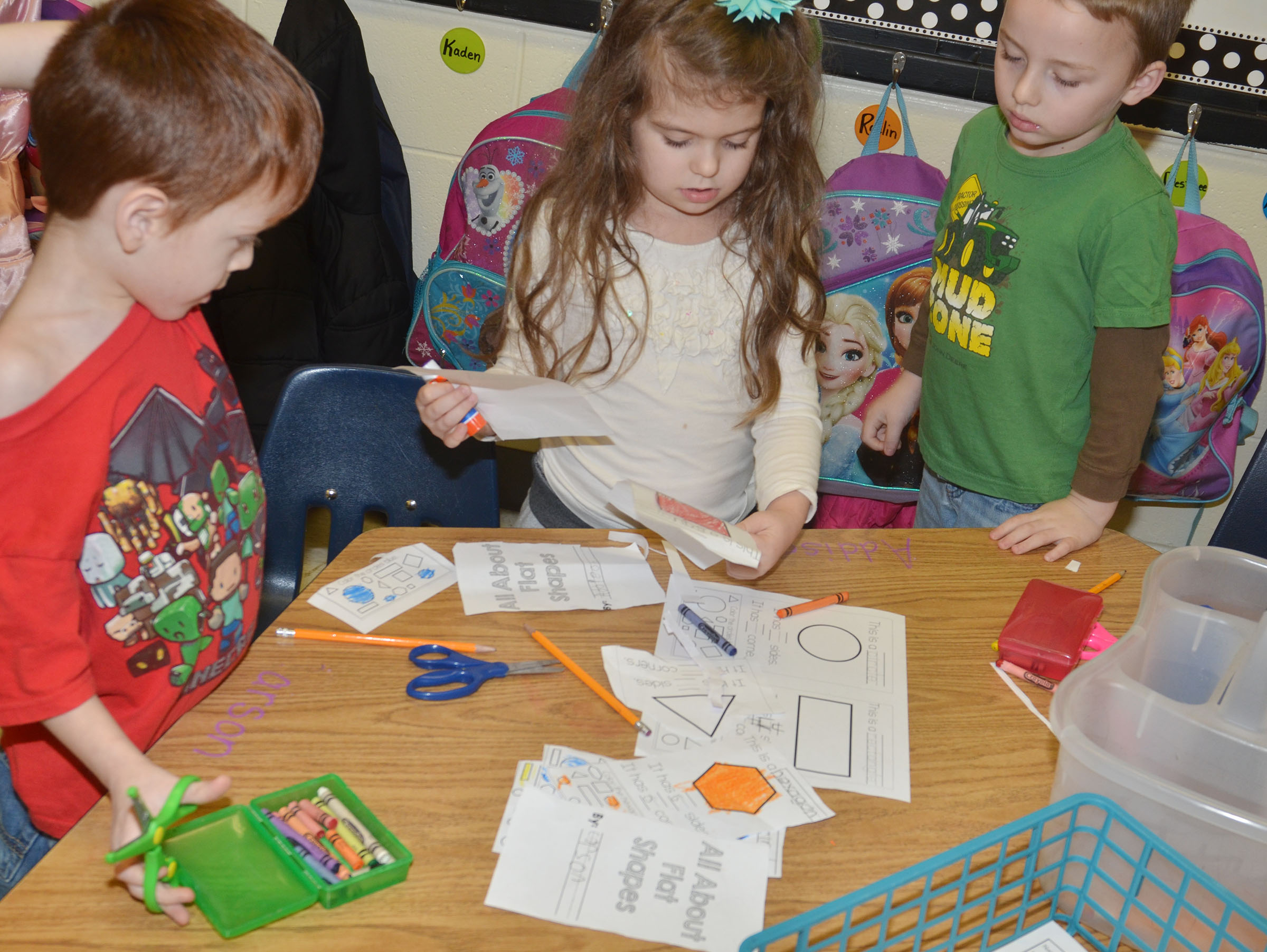 From left, CES kindergarteners Carson Montes, Addison Beckley and Ronnie Allen discuss their shapes.