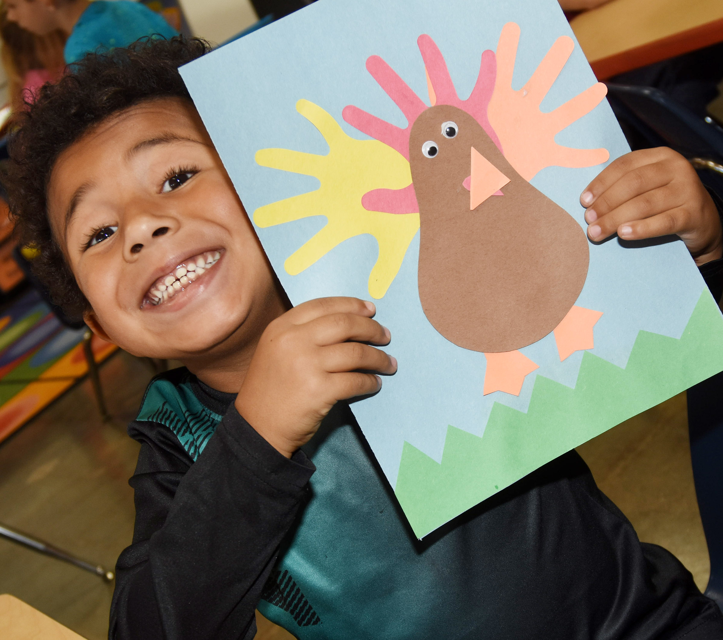 CES kindergartener Jayvian Shively holds his turkey.