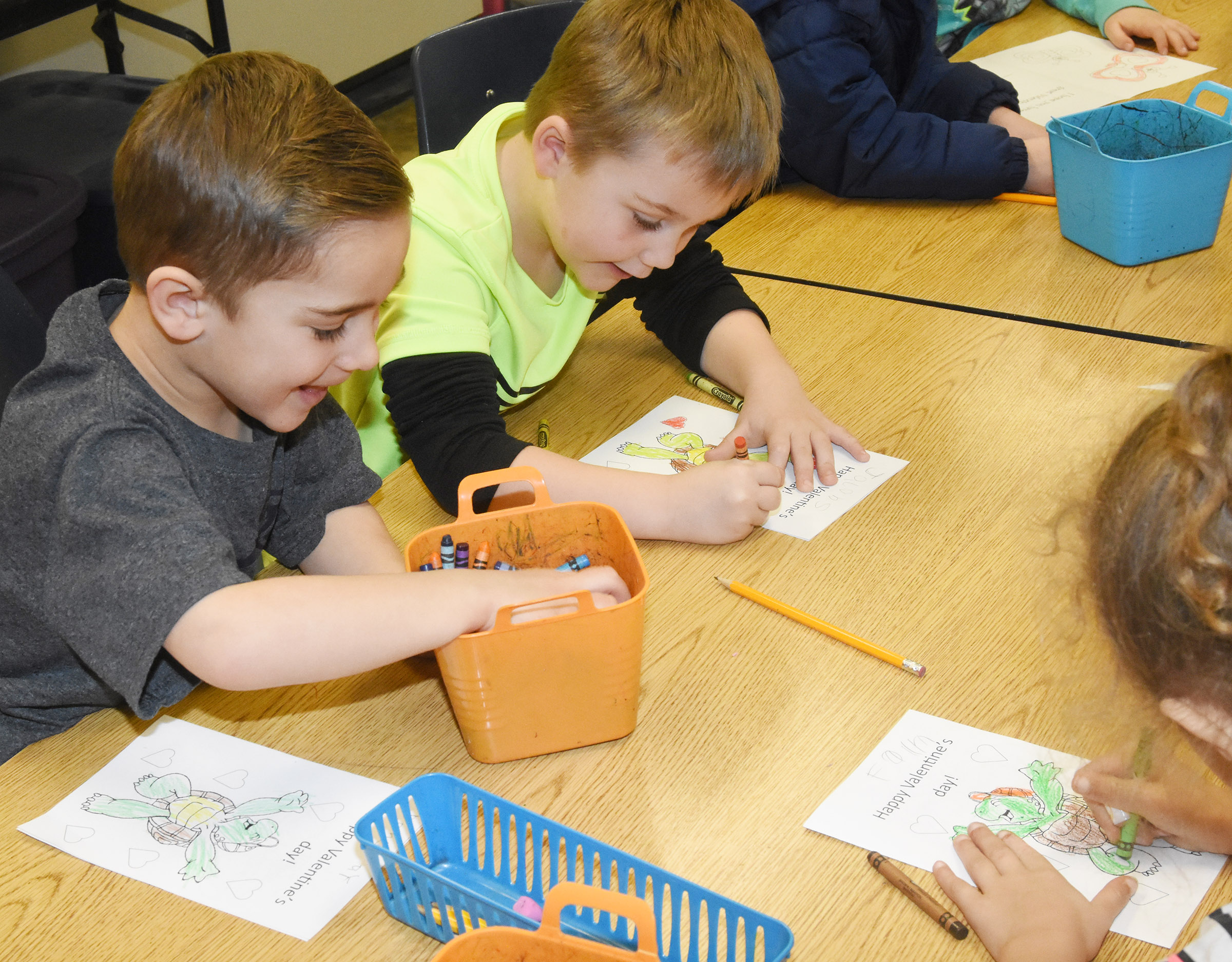 CES kindergarteners Dane Gray, at left, and Jacob Sandidge color their Valentine's Day cards.