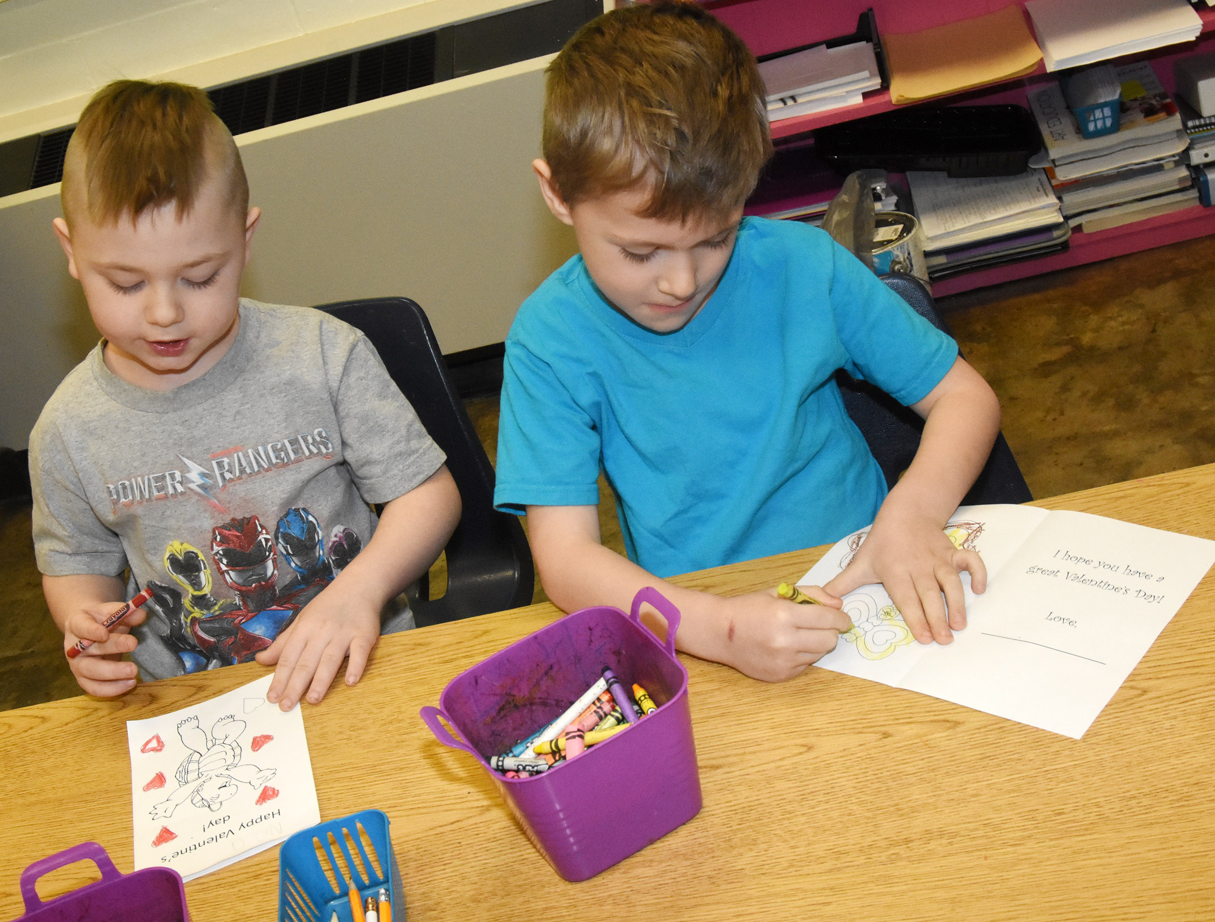 CES kindergarteners Noah Milburn, at left, and Nicholas Wilson color their Valentine's Day cards.