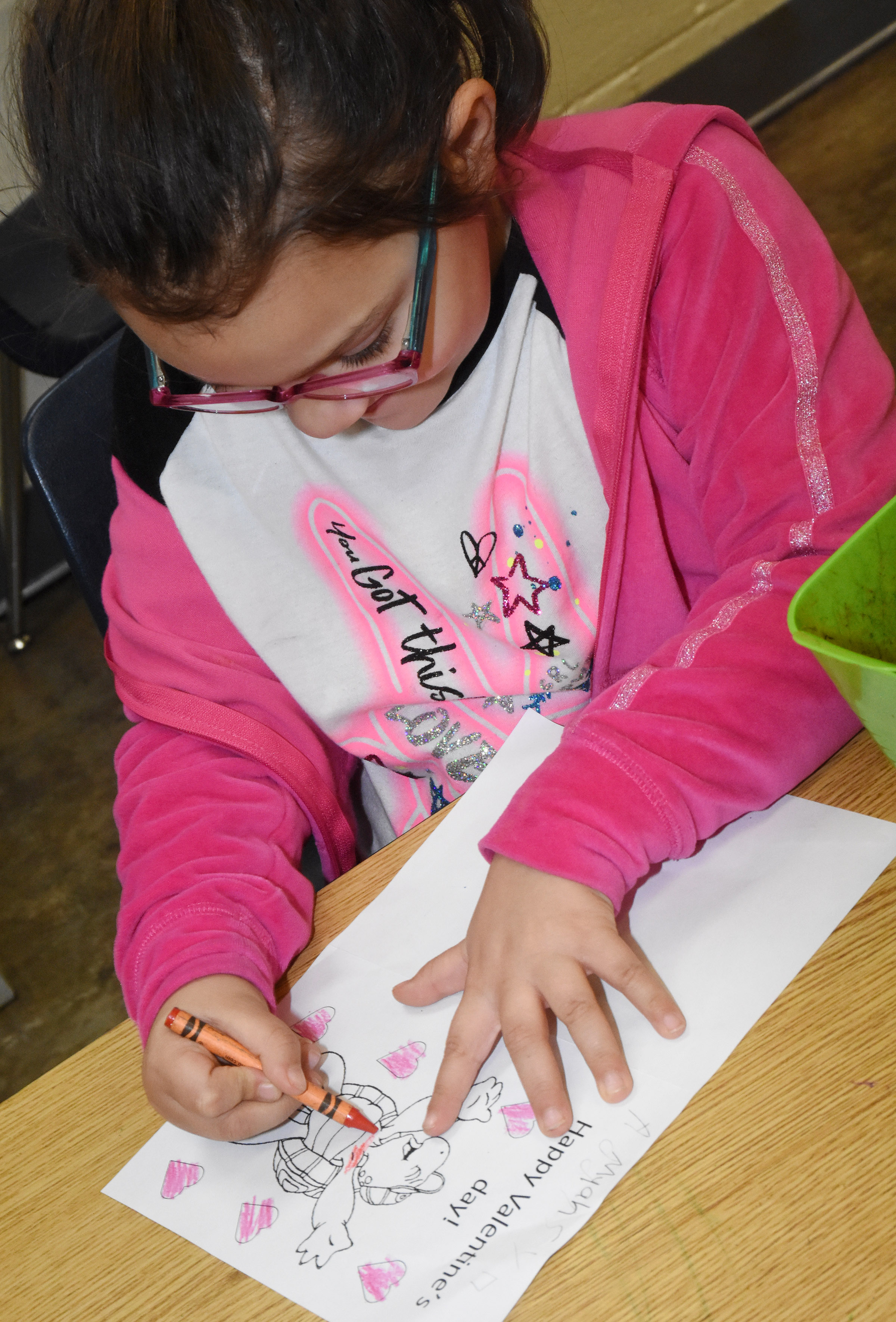 CES kindergartener Addisyn Taylor colors her Valentine's Day card.
