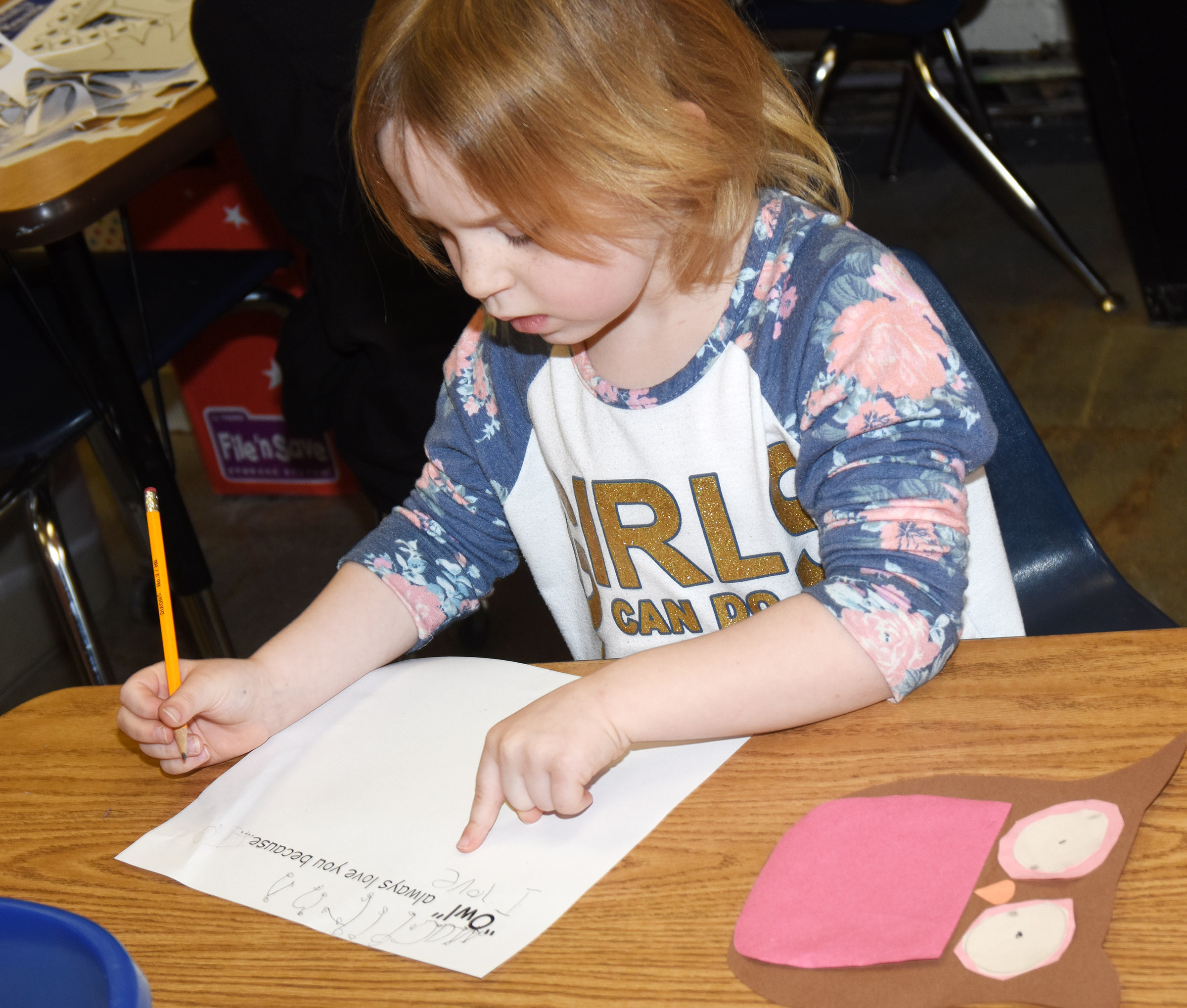 CES kindergartener Macilynn Mann finishes her Valentine writing.