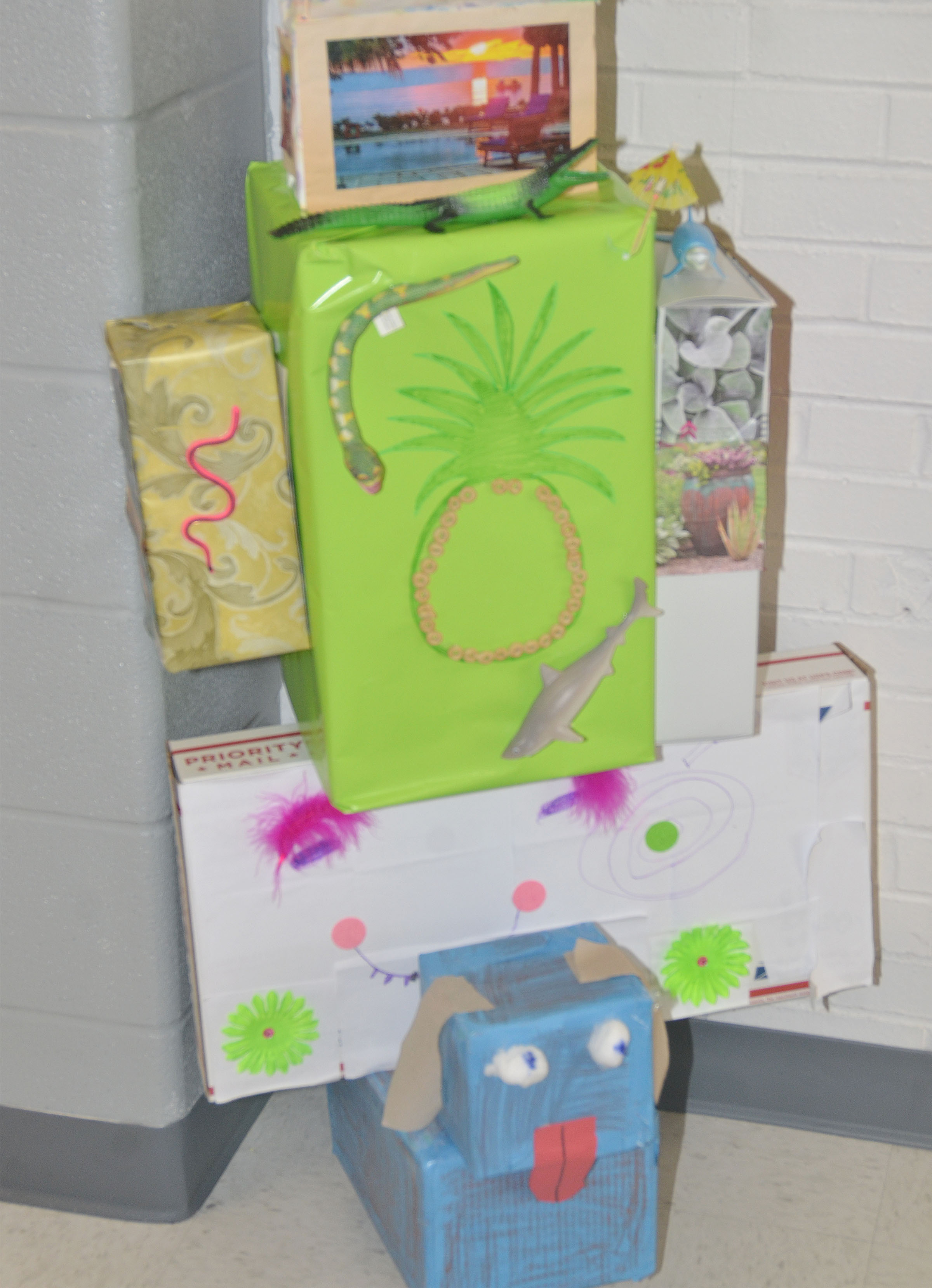 To prepare for upcoming state testing, CES third-grade teachers are decorating their hallway with a jungle theme. Students were given bonus points in their classes if they made totem pole boxes, like these, to help decorate.
